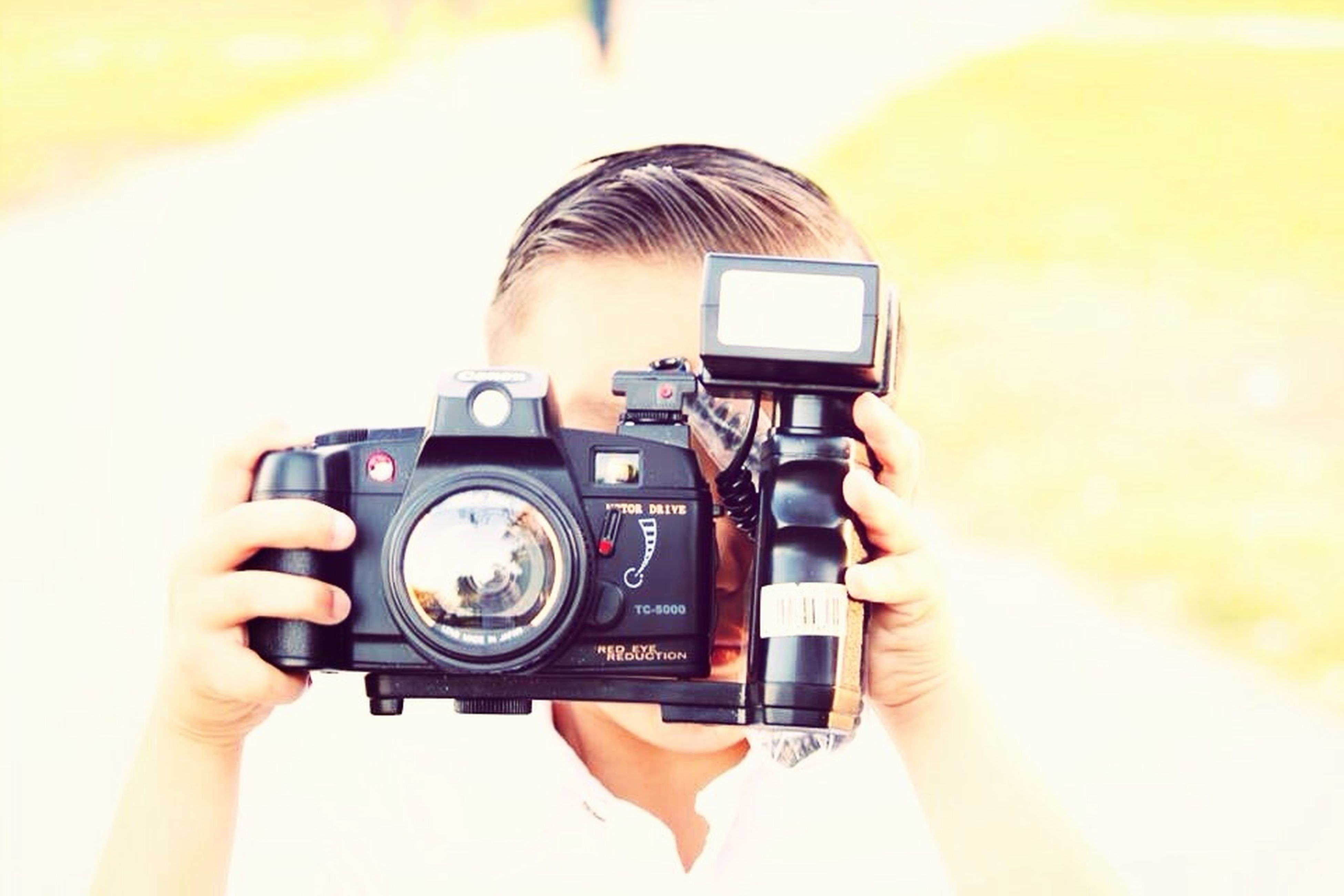 technology, photography themes, camera - photographic equipment, photographing, communication, wireless technology, holding, digital camera, smart phone, person, mobile phone, close-up, connection, lens - optical instrument, retro styled, old-fashioned, indoors, part of