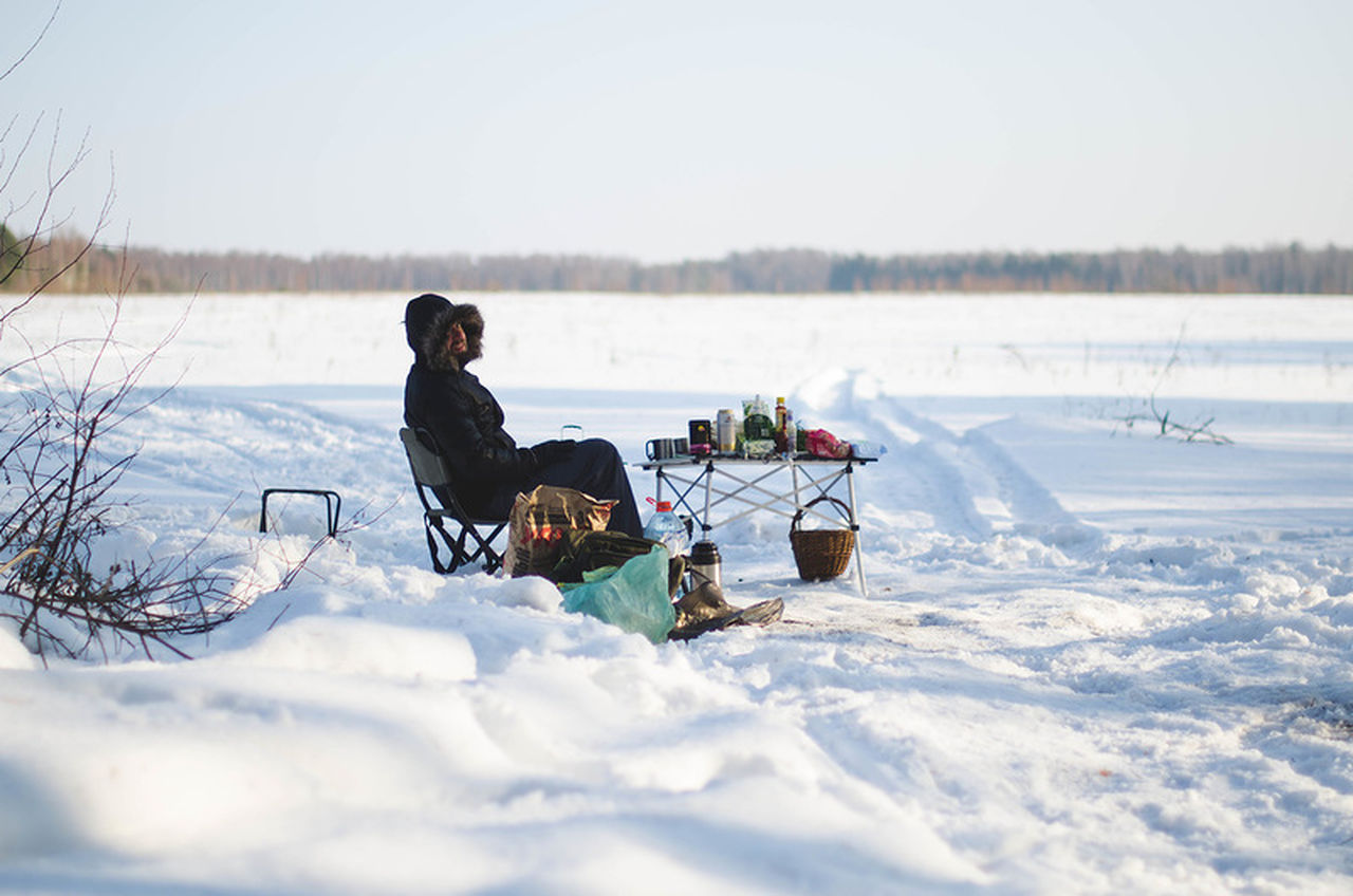 winter, real people, snow, cold temperature, nature, one person, full length, leisure activity, sitting, day, beauty in nature, lifestyles, warm clothing, outdoors, young adult, young women, sky