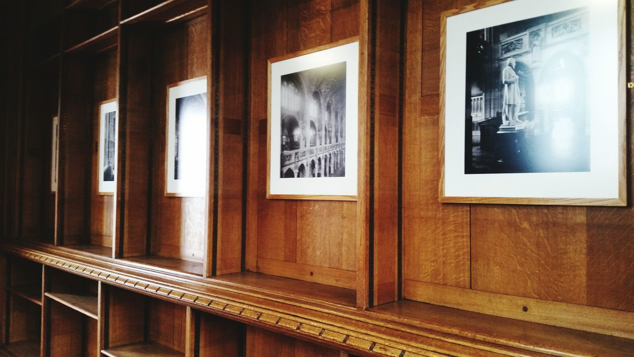 Picture Frames On Wooden Wall
