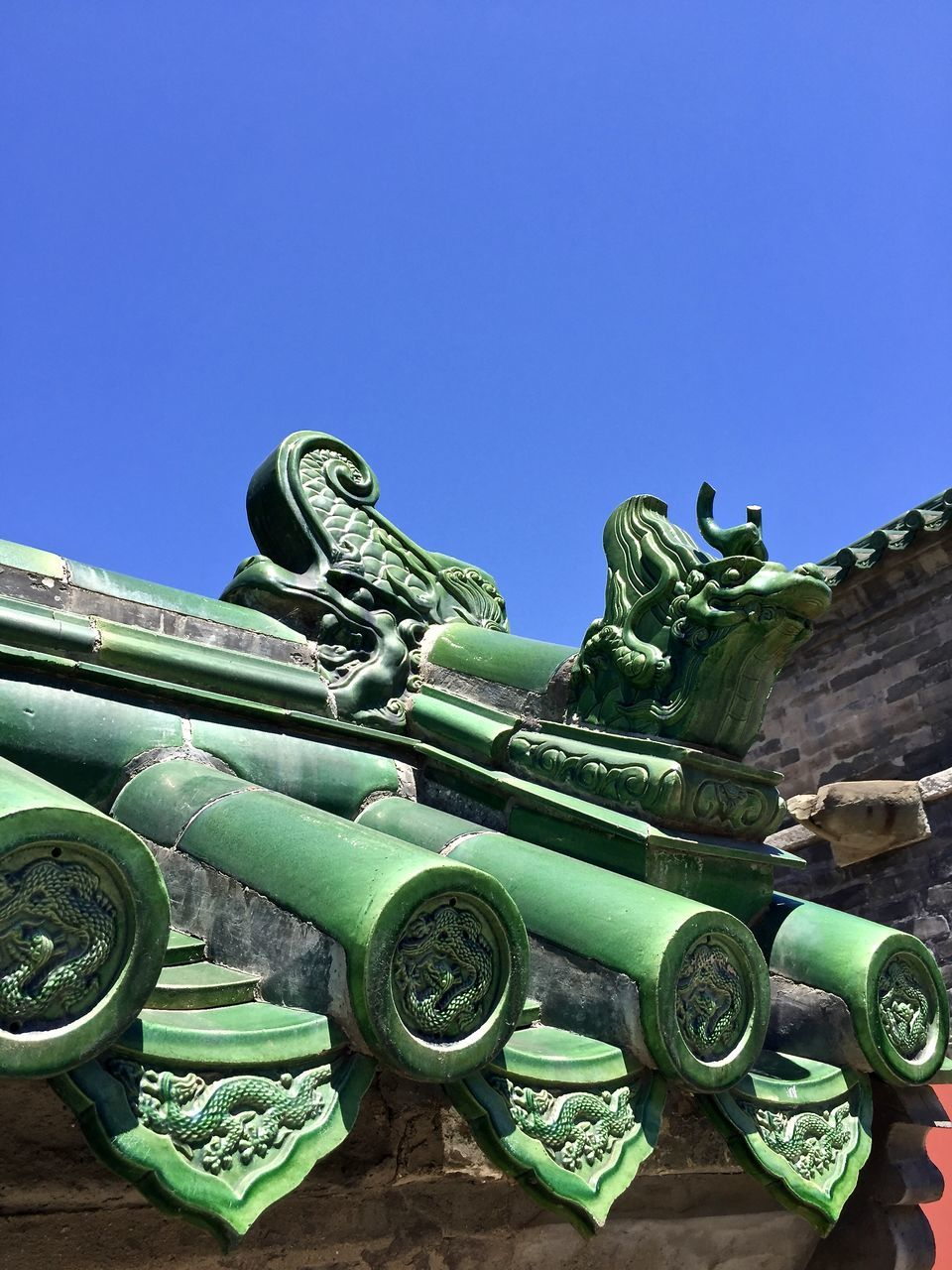 weapon, blue, metal, green color, day, low angle view, no people, clear sky, history, outdoors, military, war, sky, close-up