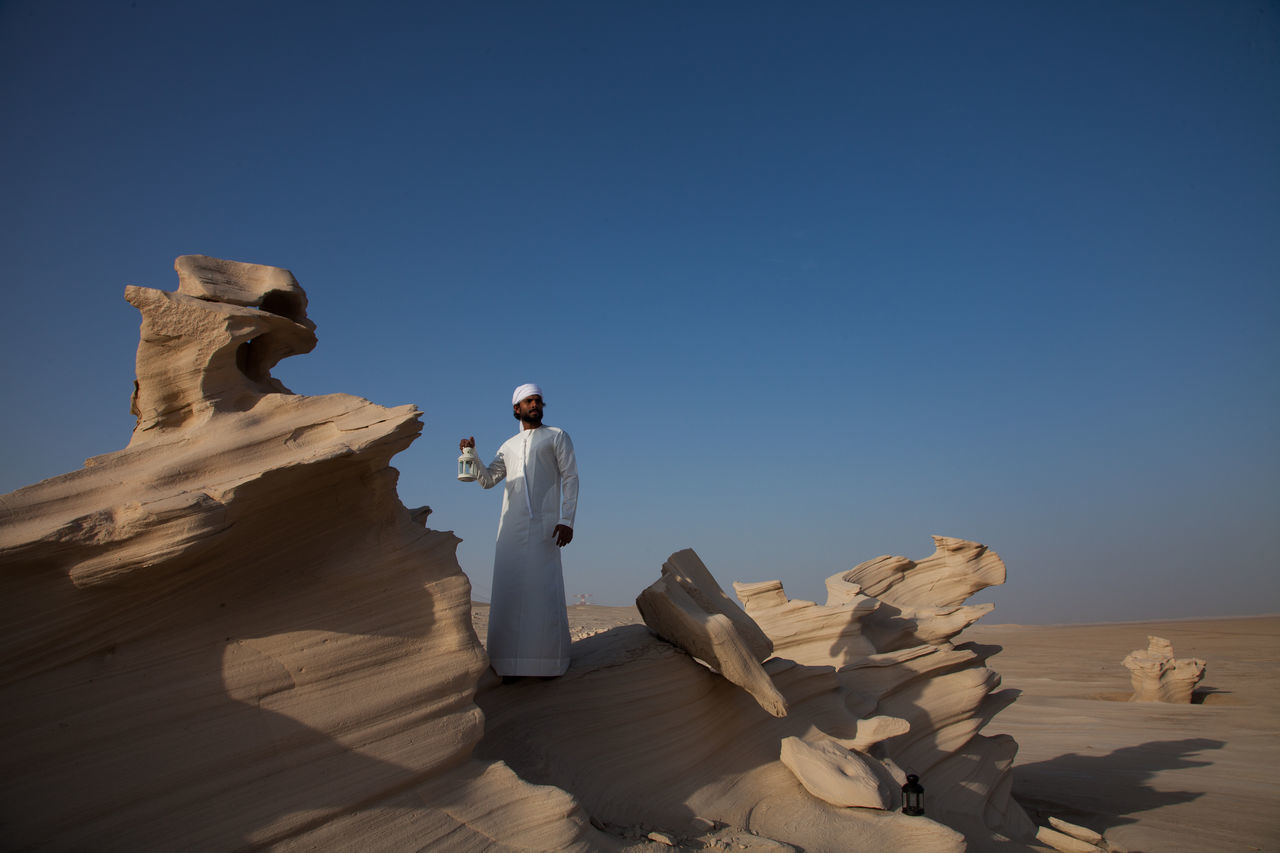 Abudhabi Arabic Arabic Style Beauty In Nature Clear Sky Day Desert Human Representation Nature No People Outdoors Scenics Sculpture Sky Statue Sunlight