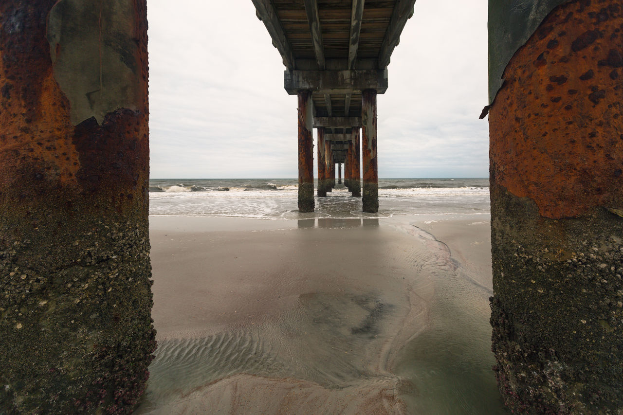 Architecture Beach Beauty In Nature Build Structure Composition Day Horizon Over Water Horizontal Symmetry Landscape Melancholy Nature No People Ocean Outdoors Pattern Pier Sand Scenics Sea Sky Textured  Under The Bridge Water