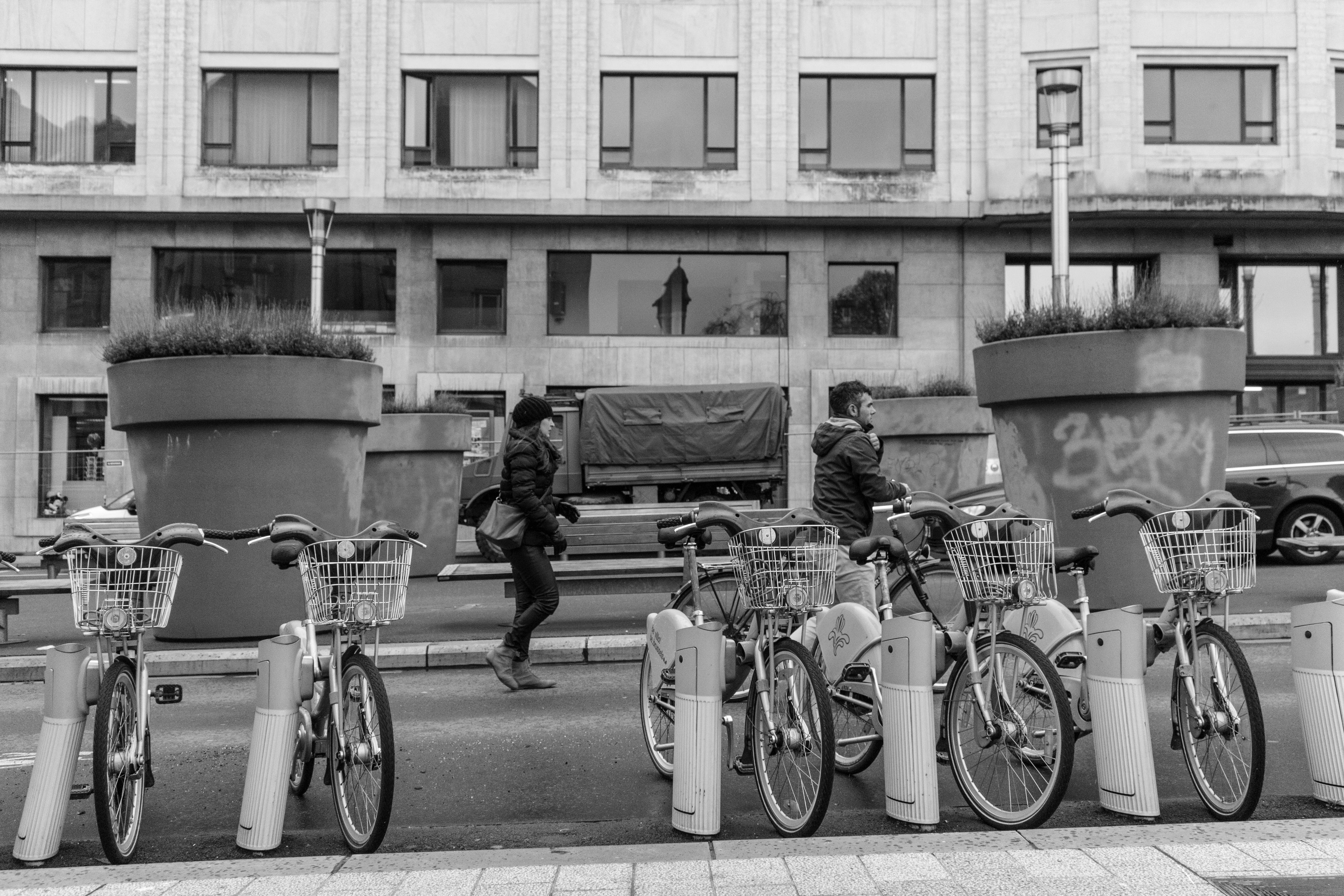 building exterior, architecture, built structure, bicycle, men, transportation, street, city, person, mode of transport, building, walking, land vehicle, lifestyles, day, window, city life, outdoors, full length