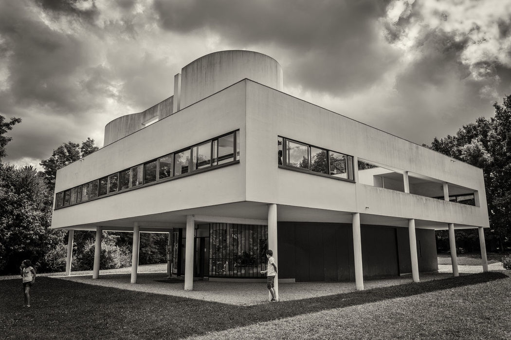 Villa Savoye designed by Le Corbusier Architectural Column Architecture Architecture Building Exterior Built Structure Cloud Cloud - Sky Cloudy Cubic Day Exterior Footpath Le Corbusier Low Angle View Minimalism Modern Architecture Office Building Outdoors Rationalism Retail  Sky Villa Villa Savoye