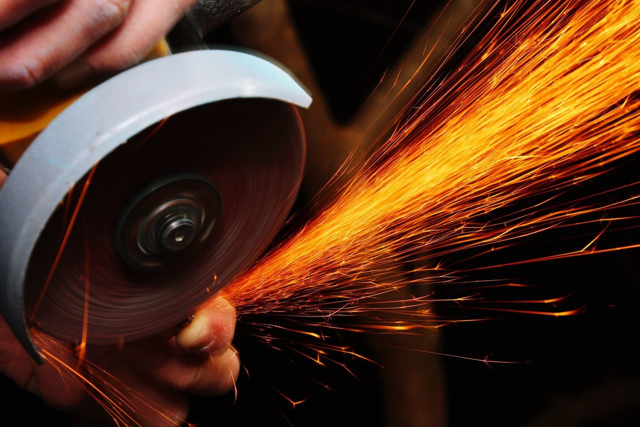 human hand, one person, working, occupation, grinding, grinder, sparks, human body part, motion, heat - temperature, men, metal industry, real people, metal, holding, indoors, human finger, blurred motion, industry, skill, cutting, long exposure, manual worker, factory, work tool, workshop, close-up, serrated, people, adult