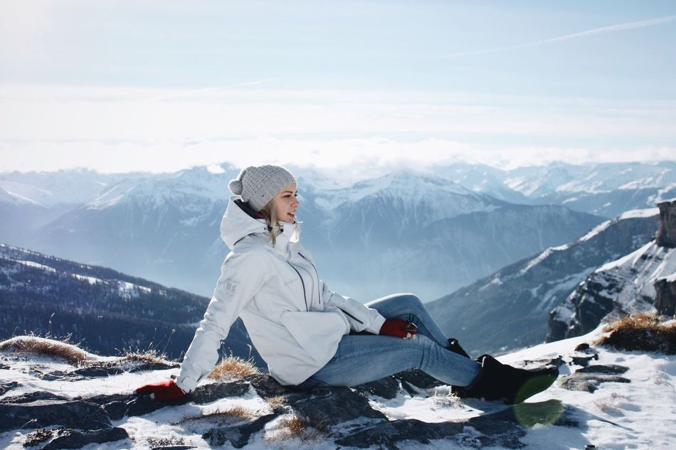 Mountain Mountain Range Rear View Cold Temperature Full Length Winter Sitting Tranquil Scene Leisure Activity Casual Clothing Lifestyles Snowcapped Mountain Non-urban Scene Season  Beauty In Nature Sky Tourist Carefree Tourism