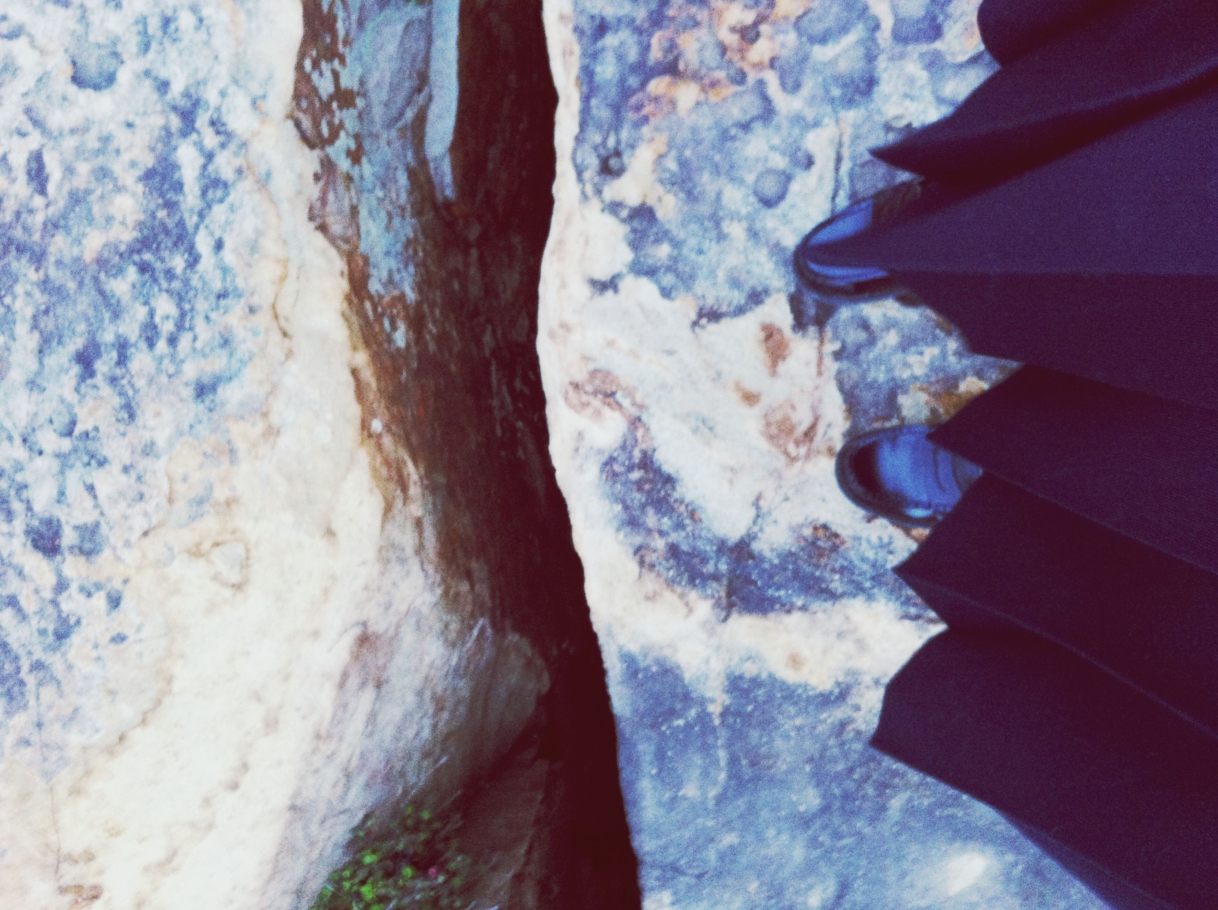 high angle view, water, blue, close-up, textured, pattern, indoors, multi colored, rock - object, day, nature, sunlight, no people, ice, transparent, beauty in nature, sea, cold temperature, frozen