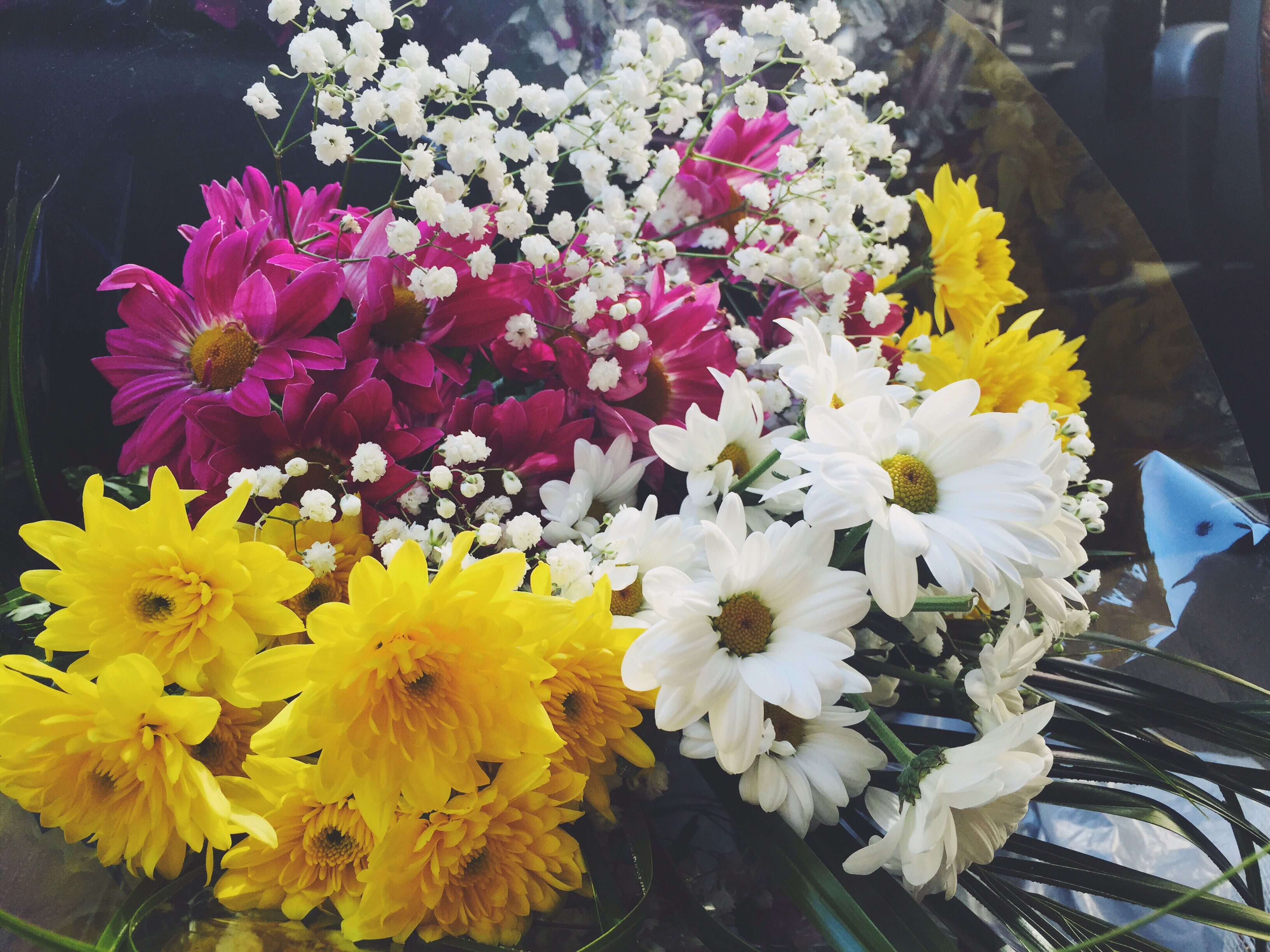 flower, petal, freshness, fragility, flower head, high angle view, beauty in nature, yellow, blooming, growth, nature, in bloom, plant, close-up, blossom, bunch of flowers, day, no people, pink color, multi colored
