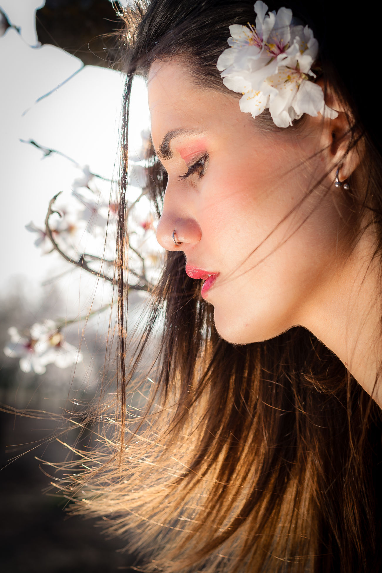 Model: Lola MUA: Noe Backlight Beauty Beauty In Nature Bokeh Brown Hair Close-up Contemplation Day Fashion Flower Focus On Foreground Headshot Long Hair One Young Woman Only Outdoors Person Serious Young Adult Young Women