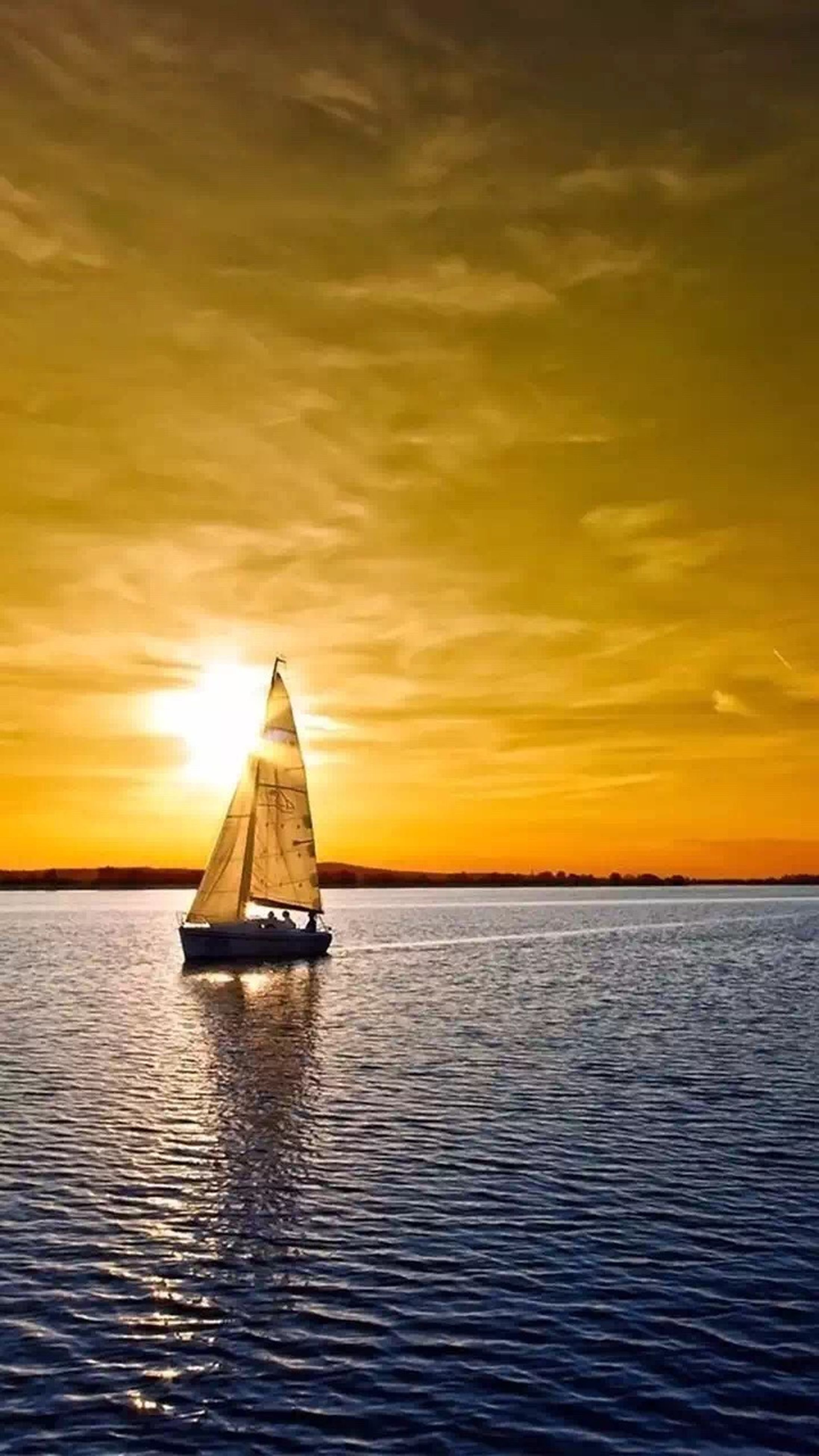 sunset, water, waterfront, sea, nautical vessel, orange color, transportation, sky, mode of transport, boat, scenics, beauty in nature, tranquil scene, tranquility, rippled, horizon over water, cloud - sky, nature, idyllic, sun