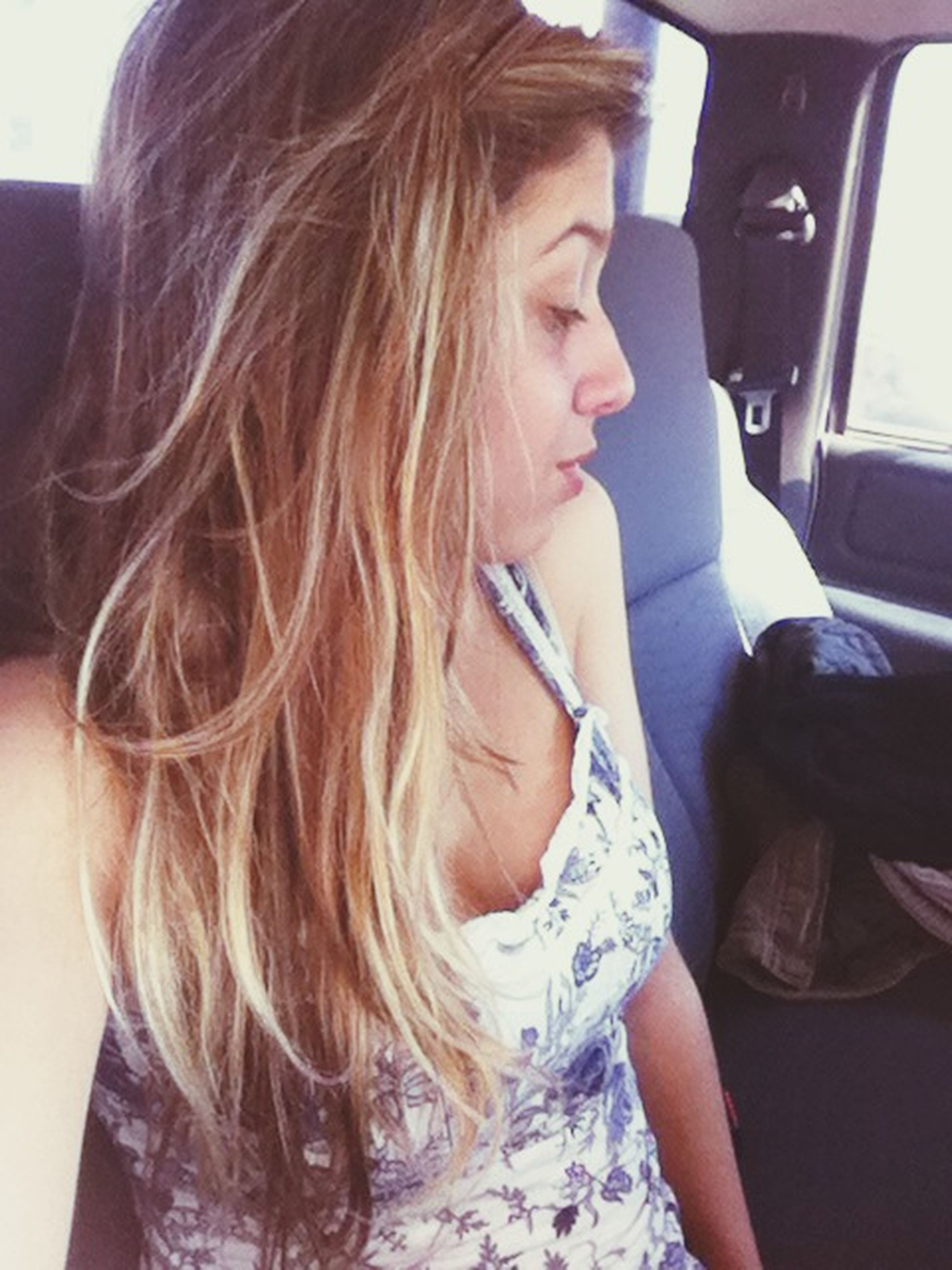 lifestyles, person, leisure activity, indoors, young women, long hair, young adult, headshot, casual clothing, vehicle interior, sitting, transportation, holding, car, brown hair, waist up, blond hair
