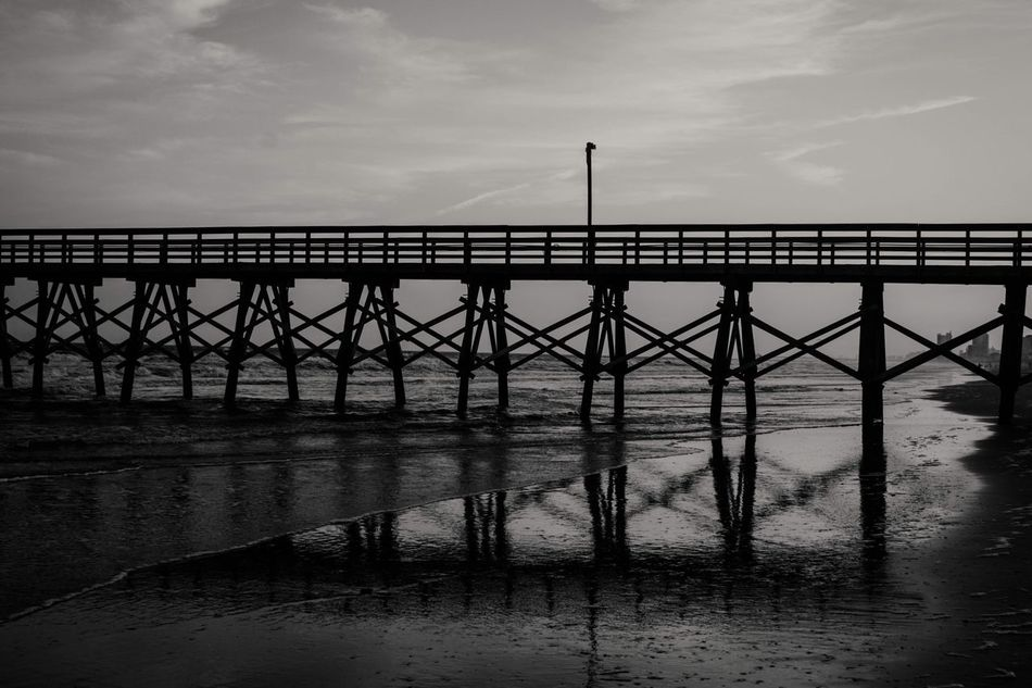 Sunset at the pier Bridge - Man Made Structure Cloud - Sky Water Sky Built Structure Architecture Connection Sea Outdoors Tranquil Scene Tranquility Nature Scenics Day No People Travel Destinations Beauty In Nature Horizon Over Water Pier Black & White Blackandwhite Black And White Ocean