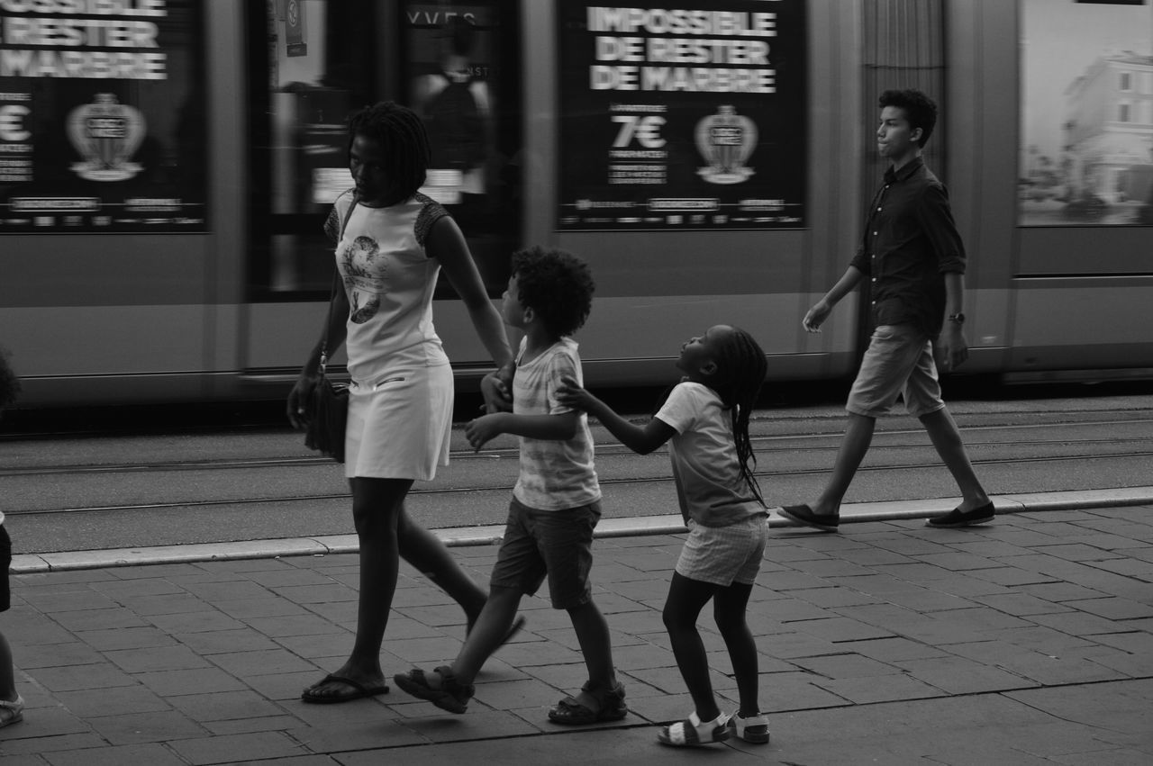 Adult Black Blackandwhite Casual Clothing Childhood City City Life Day Full Length Leisure Activity Lifestyles Men Monochromatic Monochrome Monochrome Photography Outdoors People Real People Street Street Photography Streetphotography Togetherness White Women