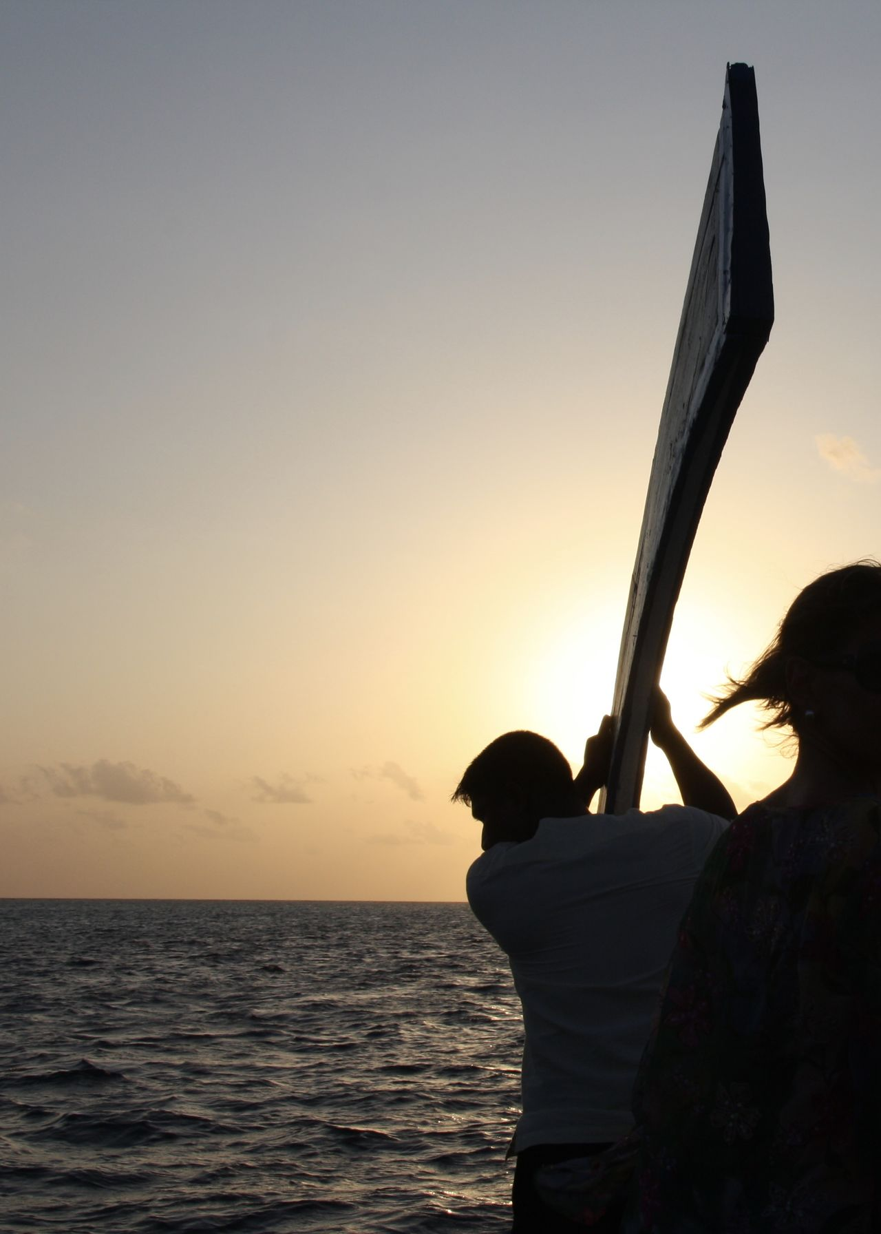 Silhouettes of Male and Female on Dhoni Boat during Sunset, Maldives Adults Only Beach Beauty In Nature Boat Clouds Colors Dhoni Dreaming Goldenhour Horizon Over Water Idyllic Indian Ocean Love Maldives Nature Outdoors Scenics Sea Silhouette Sky Sunset Sunset Silhouettes Traditional Two People Vacations