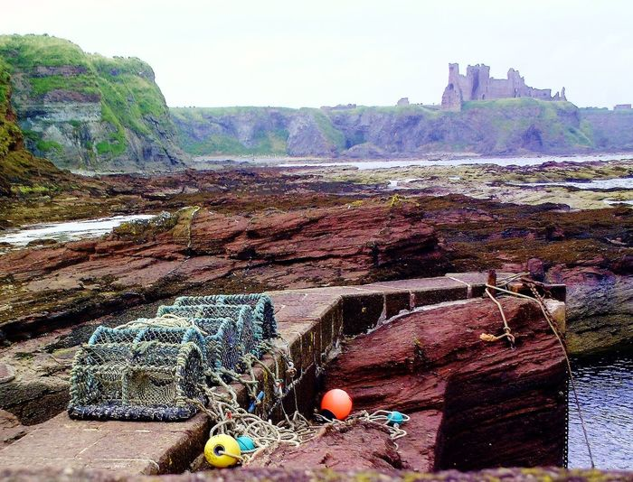Beauty In Nature Day Harbour Harbourside Idyllic Landscape Lobster Pots Mountain Nature No People Non-urban Scene Outdoors Rock Rock - Object Scenics Scotland Scotland 💕 Sky Tantallon Castle Tranquil Scene Tranquility