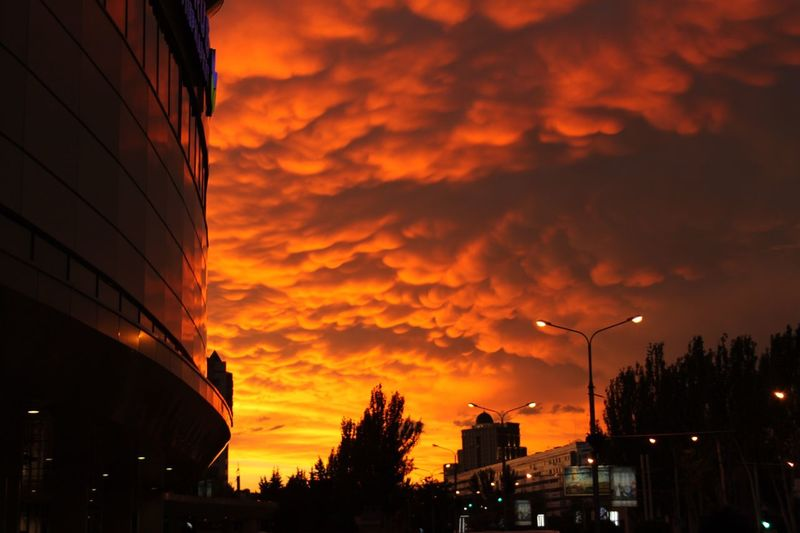 Ukraine Donetsk, Ukraine Football Euro2012 Hurricane WeatherSunset Sky Silhouette Cloud - Sky Building Exterior Built Structure Nature Low Angle View No People Architecture Electricity  Outdoors Beauty In Nature Illuminated Tree