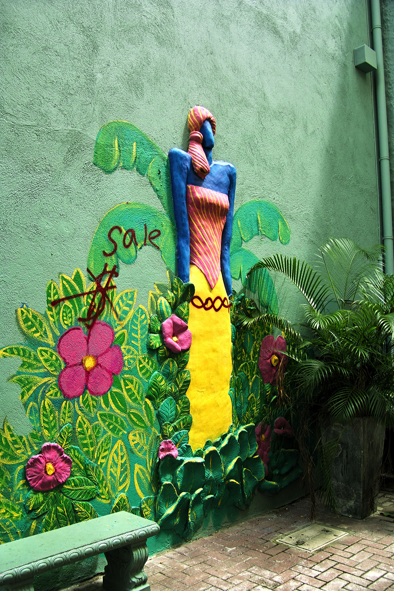 Wall art by Curaçaoan artist Nena Sanchez, victimized by graffiti Art And Craft Close-up Curacao (willemstad) Day Flower Green Color Low Section Multi Colored Nena Sanchez No People Outdoors Piece Of Art Plant Scultpure Wall Art Colorful Working