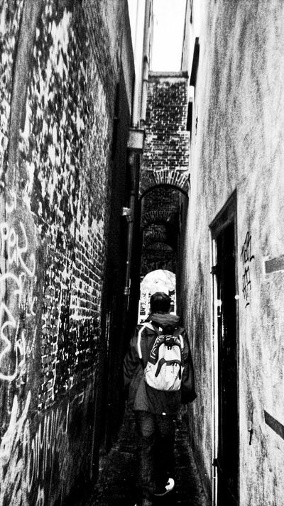 B&w Street Photography Lost in the tunnels. Tunnels Tunnel Vision Walls Wall Art Peopleandplaces Outdoors Dutchstyle Architecture Mobilephotography Samsung Wave Utrecht , Netherlands