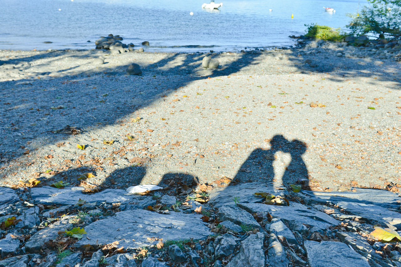 Shadows of lovers Beach Focus On Shadow Kiss Kissing Couple Lakeside Lifestyle Love Lovers Nature Outdoors People Shadow Person Relationship Rocks And Water Romantic Scenics Seaside Shadow Shadows Of People Sunlight Togetherness Travel Two Is Better Than One Vacation Water