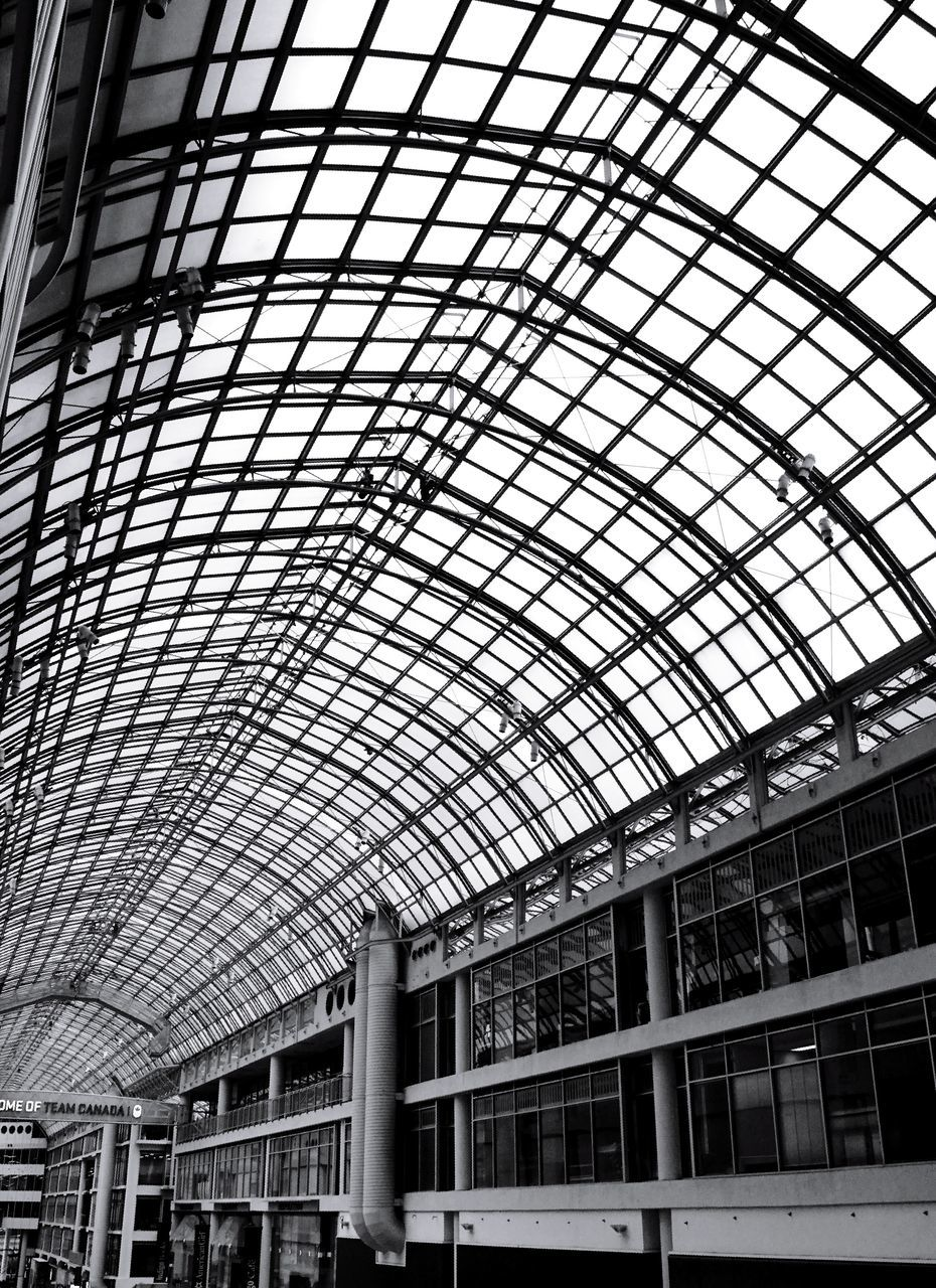 indoors, ceiling, architecture, built structure, low angle view, modern, railroad station, day, roof, no people