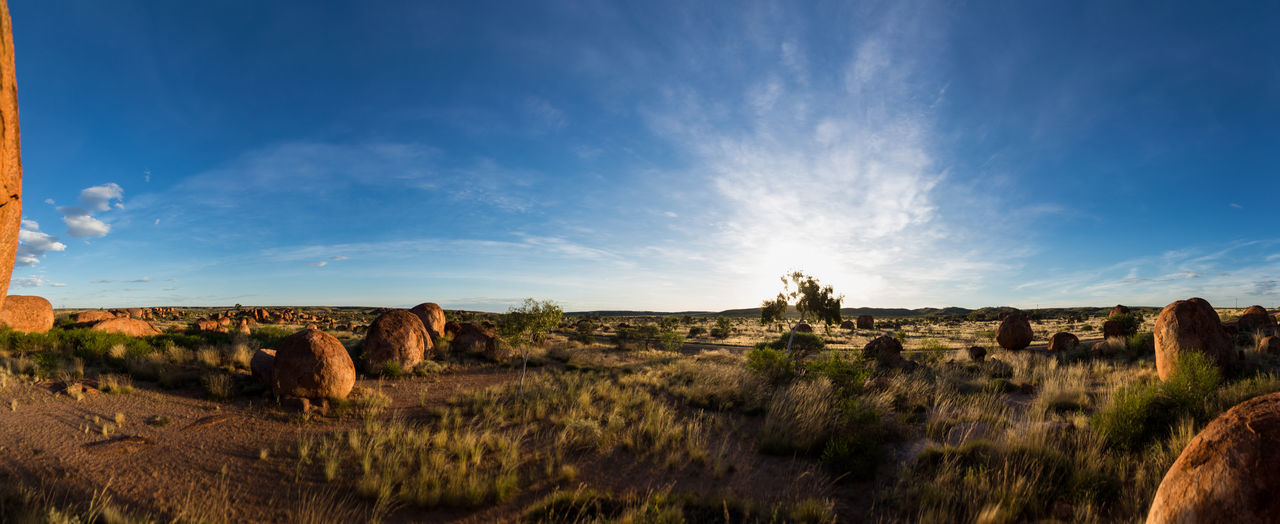 Sunset landscape at Devils Marbels, Australia Australia Backlight Beauty In Nature Cloud - Sky Devils Marbles Grass Landscape Light And Shadow Nature No People Outdoors Rock - Object Rock Formation Sky Sunset Tranquility