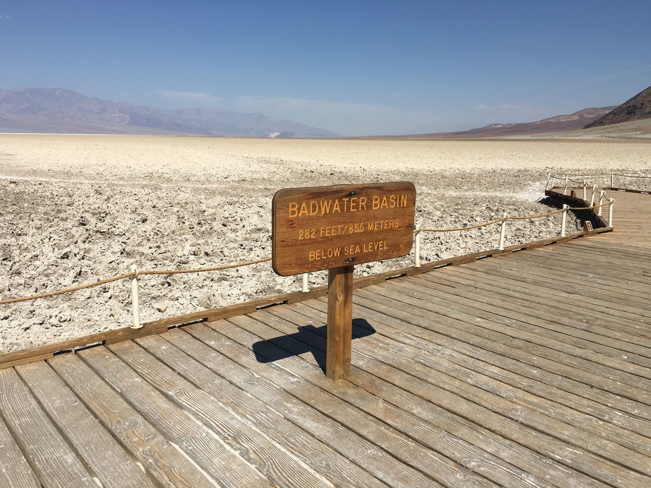 Death Valley Desert Dry Mountain Nature No People Outdoors Salt Lake Scenics Signboard Western Script