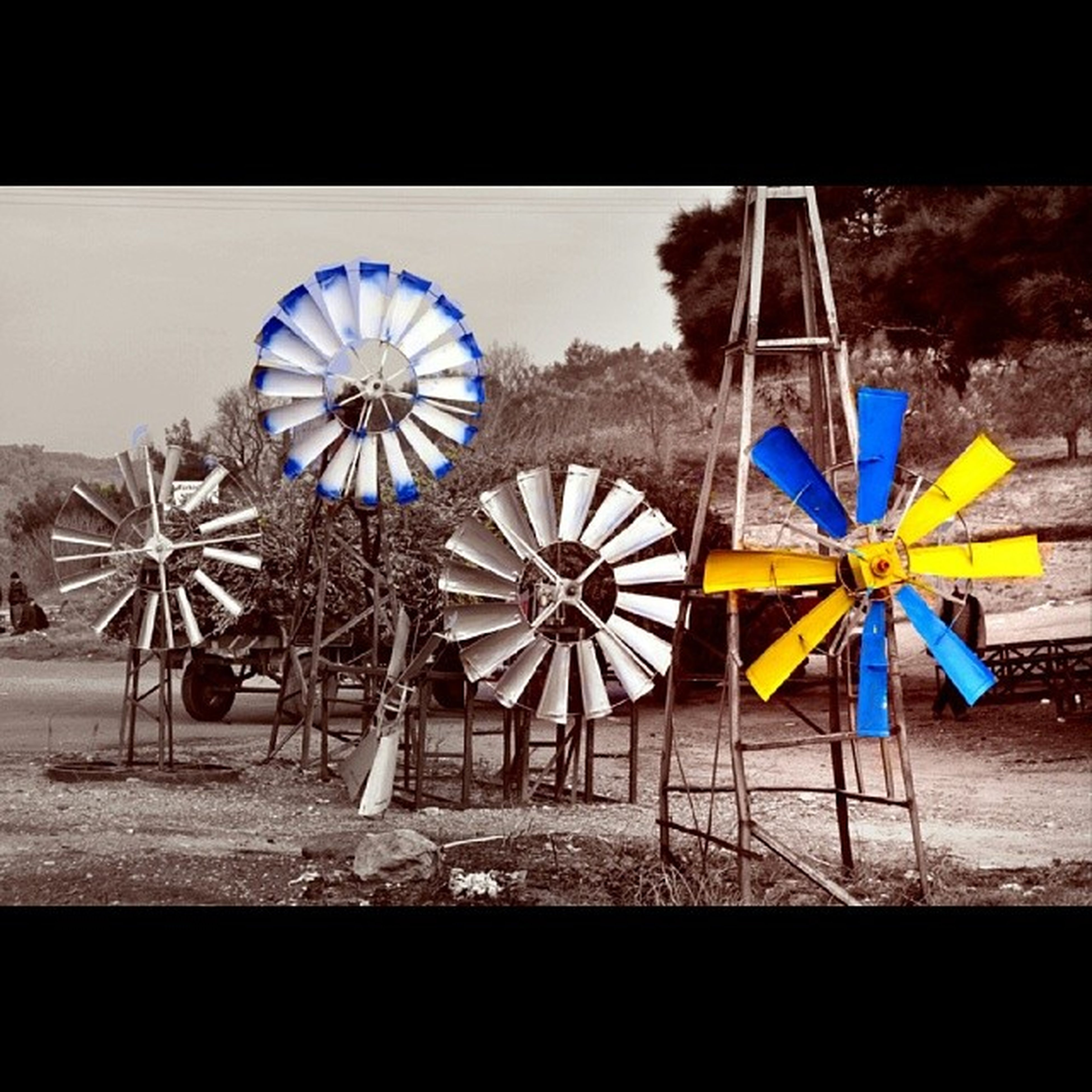 no people, day, wall - building feature, blue, auto post production filter, abandoned, yellow, outdoors, absence, creativity, art and craft, multi colored, art, sunlight, built structure, wall, metal, transfer print, wheel