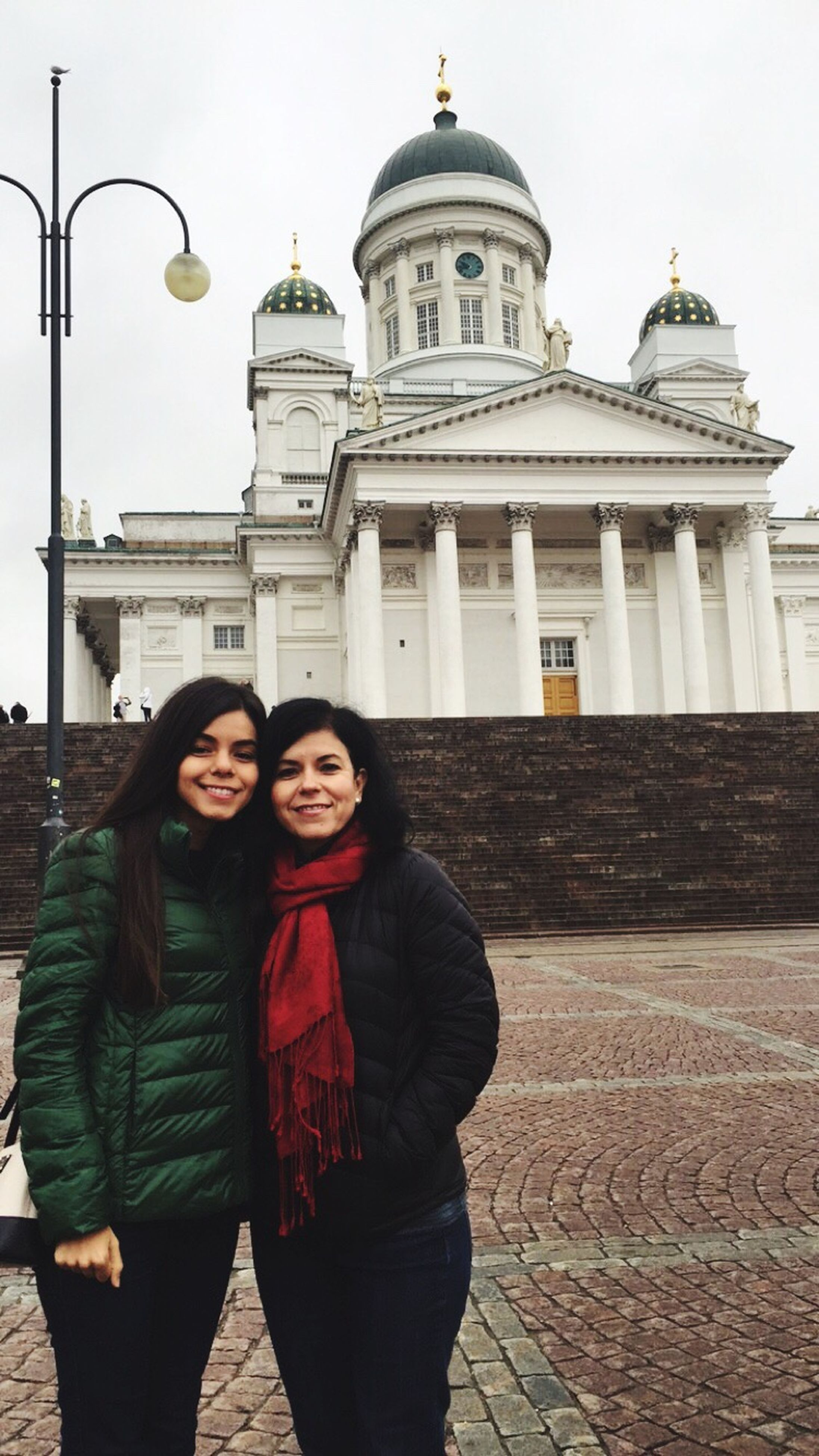 two people, togetherness, young women, dome, young adult, architecture, city, portrait, smiling, adults only, travel destinations, black hair, looking at camera, built structure, standing, building exterior, women, adult, lifestyles, happiness, real people, outdoors, vacations, cheerful, friendship, people, only women, beautiful woman, day