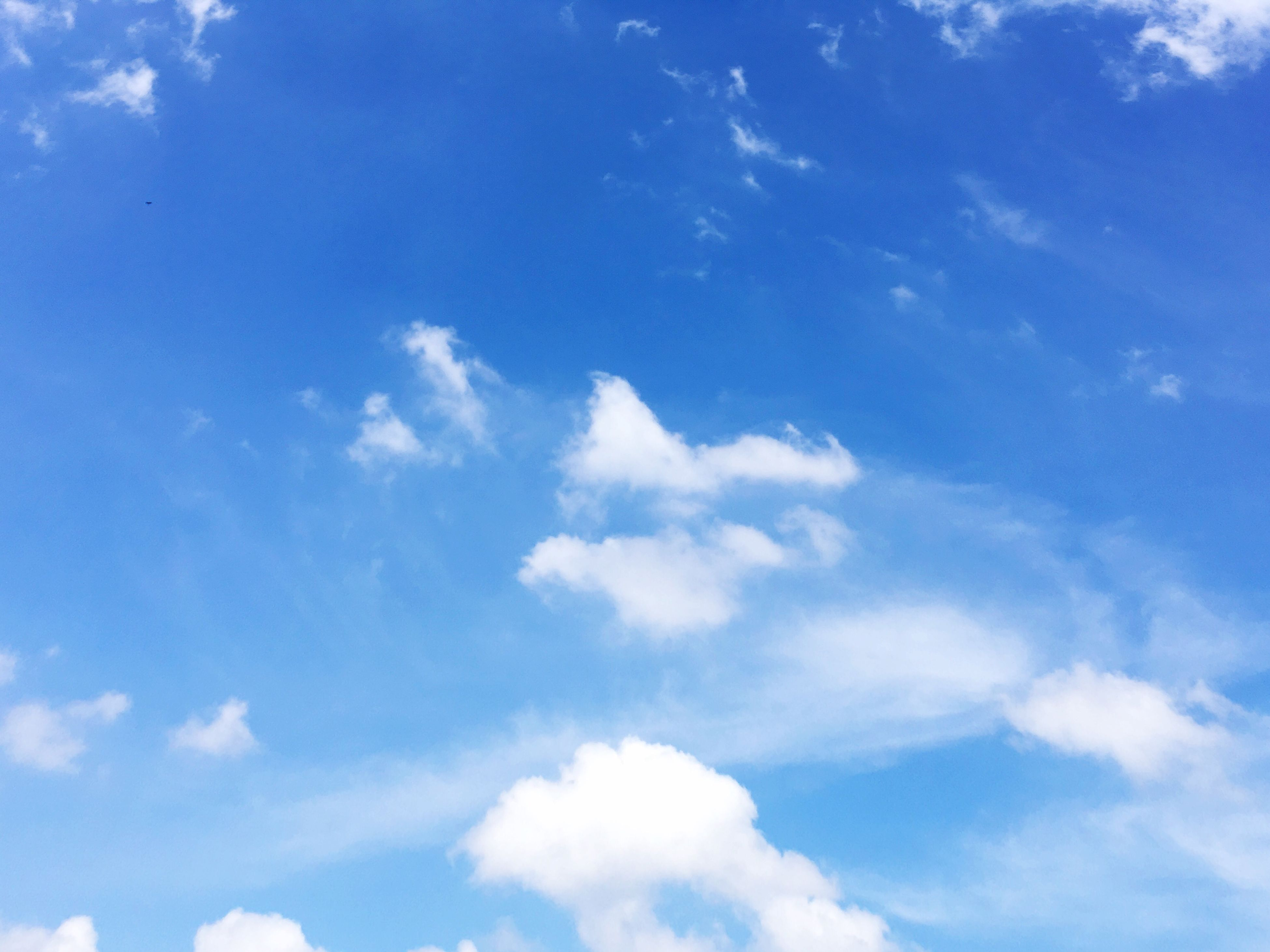 sky, cloud - sky, low angle view, blue, nature, tranquility, beauty in nature, idyllic, scenics, backgrounds, no people, day, sky only, outdoors
