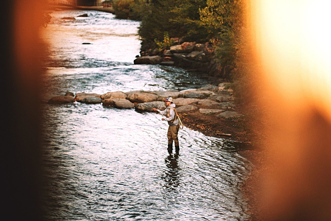 Fly fishing in a stream near Coors Brewery outside of Golden, CO water real people leisure activity sunset river outdoors Nature adventure lifestyles beauty in Nature Coors brewery Golden Colorado