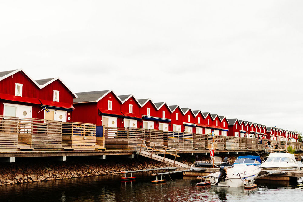 Row Houses Architecture Building Exterior Built Structure Colorful Fishing Harbour Houses Journey Lake View Lakeshore Lakeside Multi Colored Red Red Rows Of Things Scandinavia Sea Sky Summer Sweden Transportation Vännern Water Waterfront