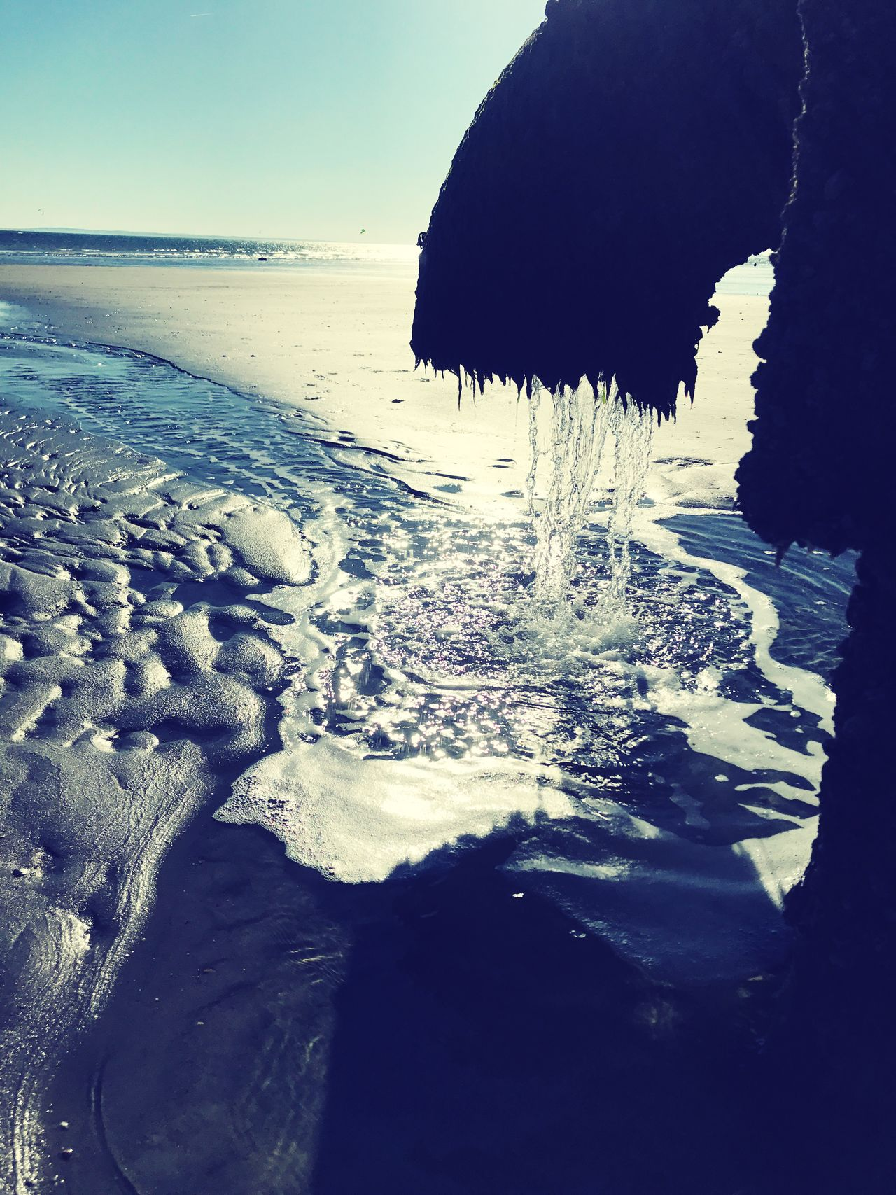 Returning the water to the sea. Water Sea Beach Beauty In Nature Scenics Tranquility Horizon Over Water Outdoors Sand Wave The Great Outdoors - 2017 EyeEm Awards EyeEmBestPics EyeEm Best Shots EyeEmNewHere Vacations Peace Pipe Splash Water Flow Dripping Sunlight Sun Rays Froth Bubbles