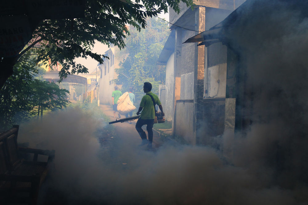 Fumigation is done in neighborhood residents in Cakung, East Jakarta, to prevent the breeding of mosquitoes. Activity Adult Adults Only Breeding Day Environment Featuremeinstagood Fog Fogging Foggy Foggy Morning Fumigation  Man Mosquito People Social Issues