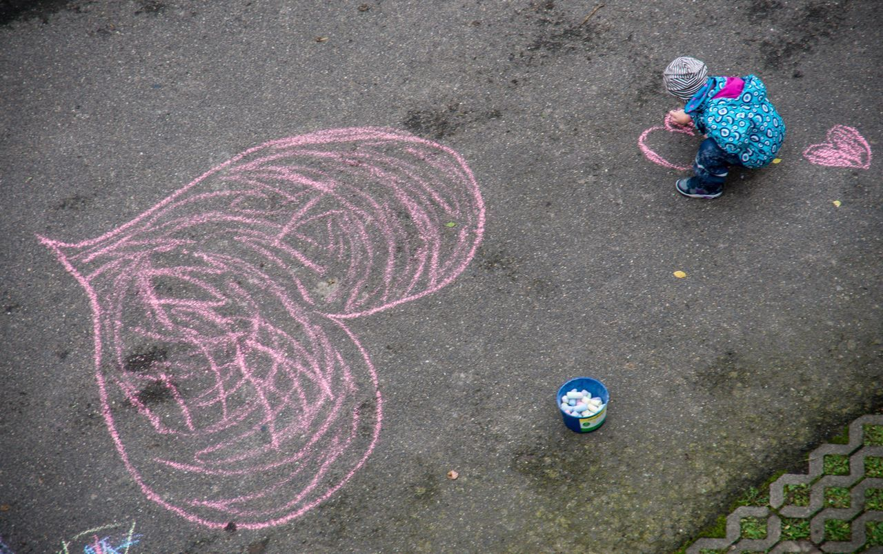 street art / Asphalt Chalk Chalk Art Children Day Drawing - Art Product EyeEm Best Shots Heart Heart Shape High Angle View Kids Kids Being Kids Little Girl Looking Down Multi Colored Outdoors Painting Playing Street Art Street Photography Urban Love Love ♥ Love Is In The Air Lovely