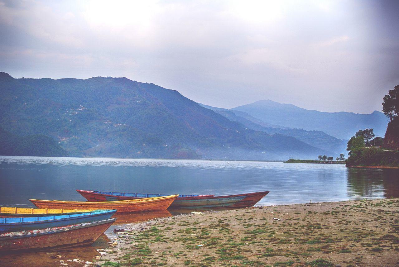 Canoes on the lake Pokhara Nepal Lake Lake View Landscape Travel Photography Travel Canoe Pure Calm Canoeing Colorful