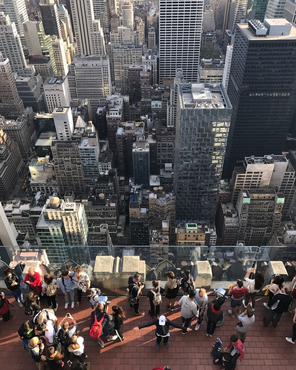 architecture, skyscraper, city, building exterior, cityscape, built structure, high angle view, modern, travel destinations, large group of people, tower, real people, men, city life, urban skyline, aerial view, outdoors, day, women, people, adult
