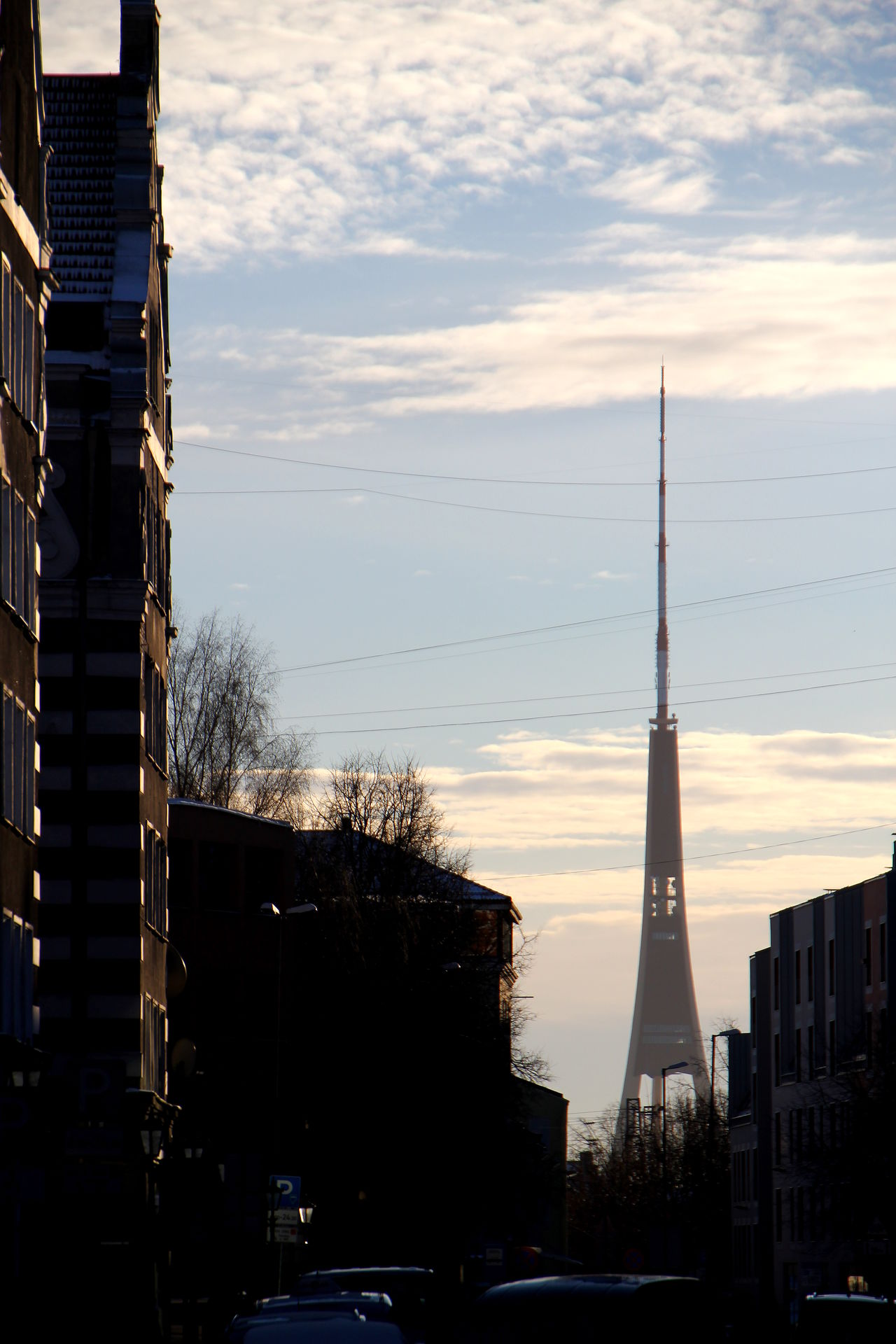 Antenna - Aerial Architecture Bare Tree Broadcasting Building Exterior Built_Structure City Cloud - Sky Day Nature No People Outdoors Riga RigaCity Sky Skyscraper Tall - High Technology Tower Tree Winter The City Light Minimalist Architecture Welcome To Black The Architect - 2017 EyeEm Awards Neighborhood Map Let's Go. Together.