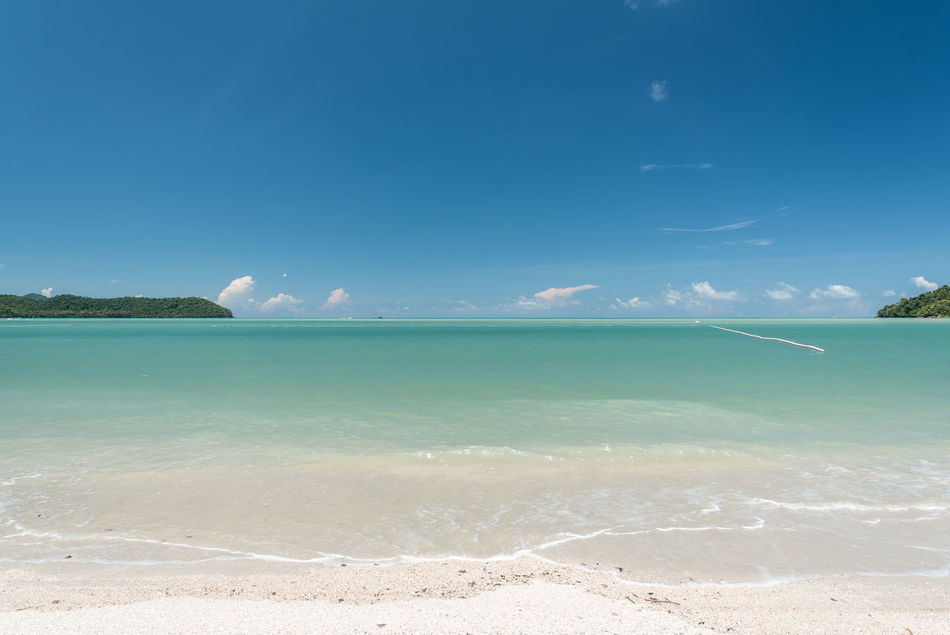 Beautiful beach with crystal clear water. Beach Beautiful Nature Blue Clear Water Cloud - Sky Coastal Feature Coastline Day Holiday Horizon Over Water Landscape Nature No People Outdoors Sand Scenics Sea Sky Sunny Tourism Tranquility Travel Destinations Vacations Water Wave