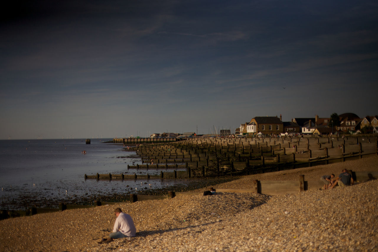 beach in whitstable with dark sky Beach Beauty In Nature Cloud Cloud - Sky Coastline Day Horizon Over Water Idyllic Nature Ocean Outdoors Scenics Sea Shore Sky Tourism Tranquil Scene Tranquility Travel Destinations Water