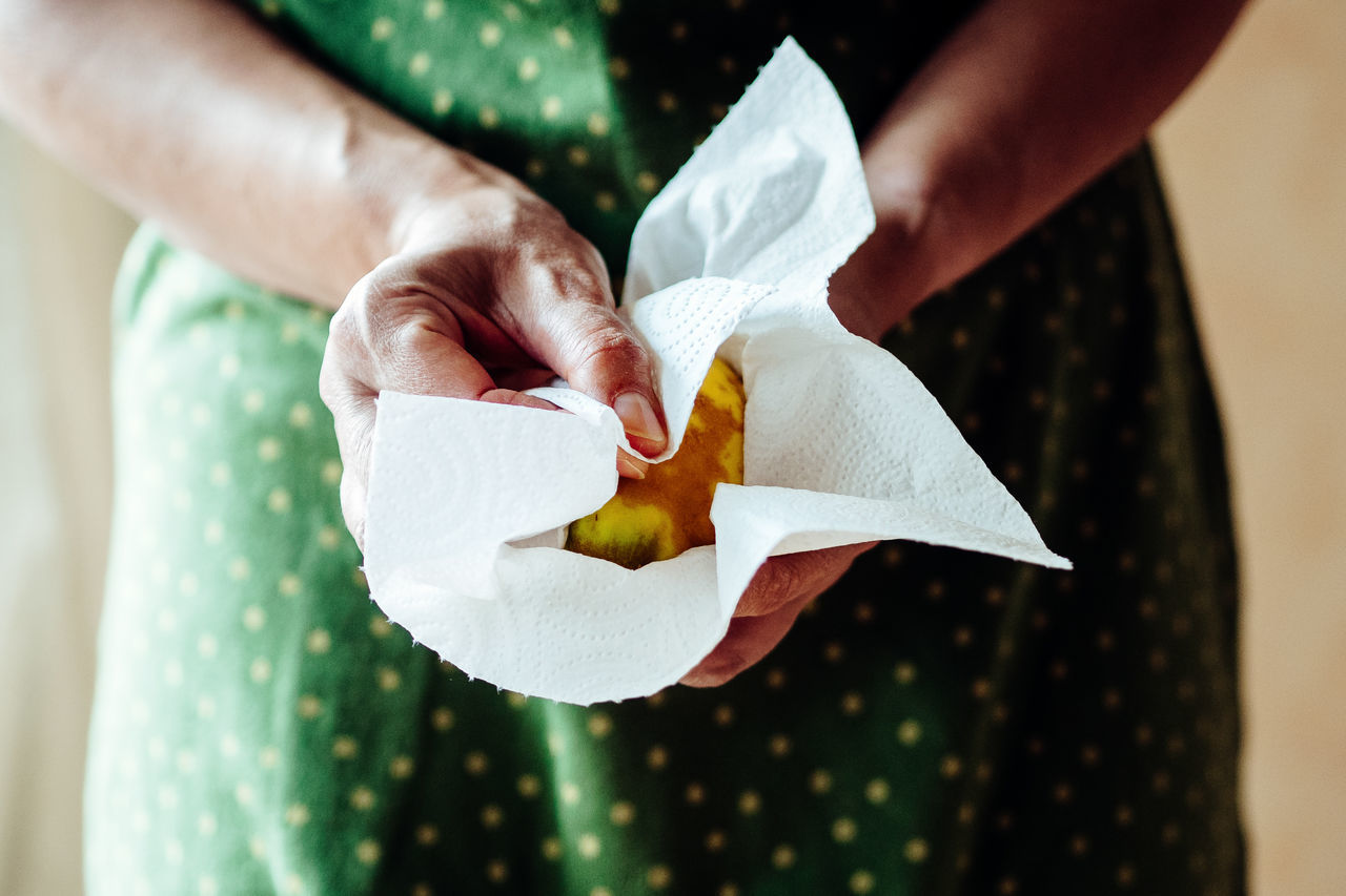 cleaning a quince Cleaning Focus On Foreground Freshness Fruit Healthy Eating Healthy Food Holding Homemade Food Kitchen Kitchen Life Making Jam Person Quince The Week On EyeEm Focus Object
