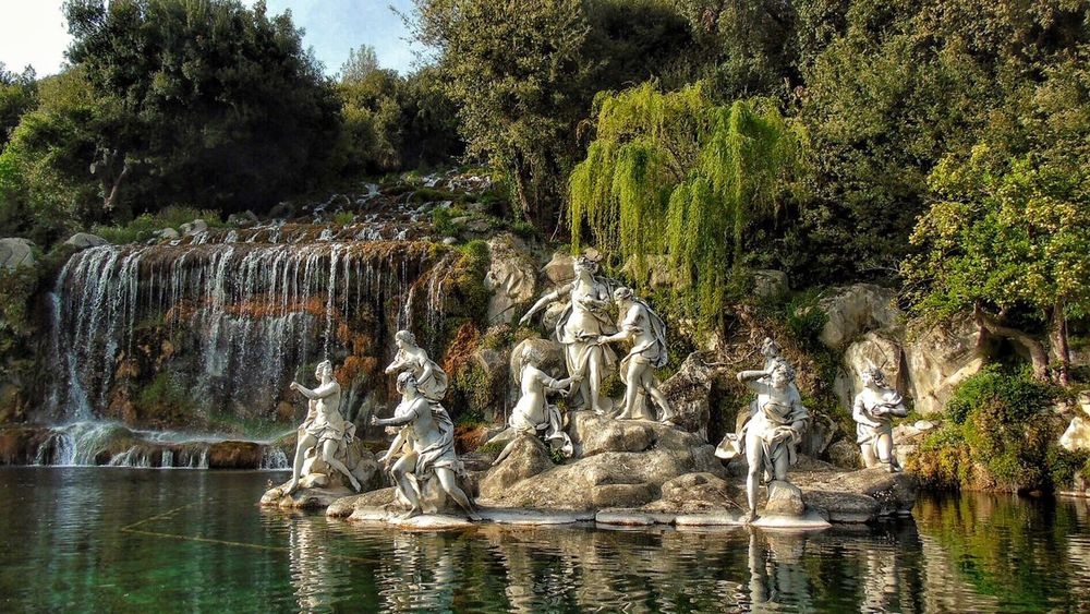 Water Tree Waterfront Nature Rock - Object River Animal Themes Outdoors Day Plant No People Beauty In Nature Waterfall Animals In The Wild Mammal Sculpture Reggia Di Caserta Photography Beauty In Nature Amazing Scenics EyeEmNewHere
