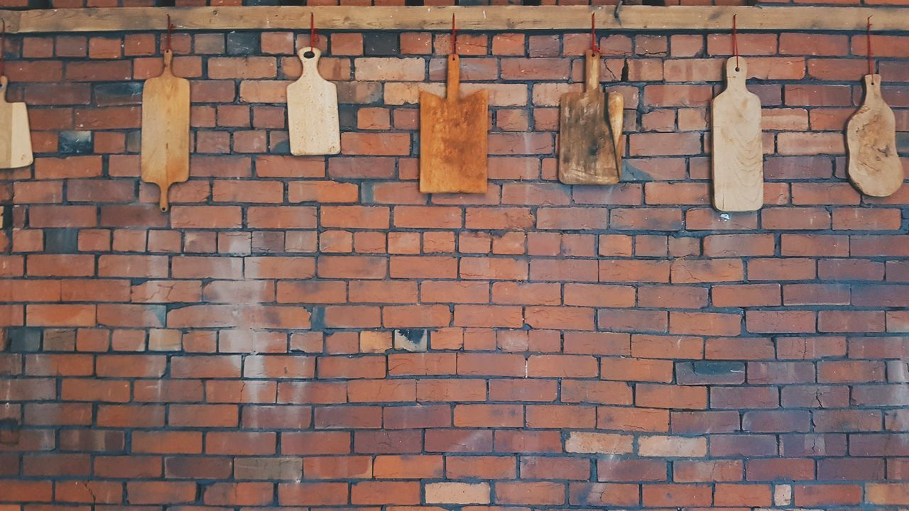 Industrial Brick Wall Full Frame Backgrounds No People Outdoors Day Brown Communication Hanging Architecture Bare Brickporn Brick Wall Wood Paddles Cheese Board Boards Serving Paddles Serving