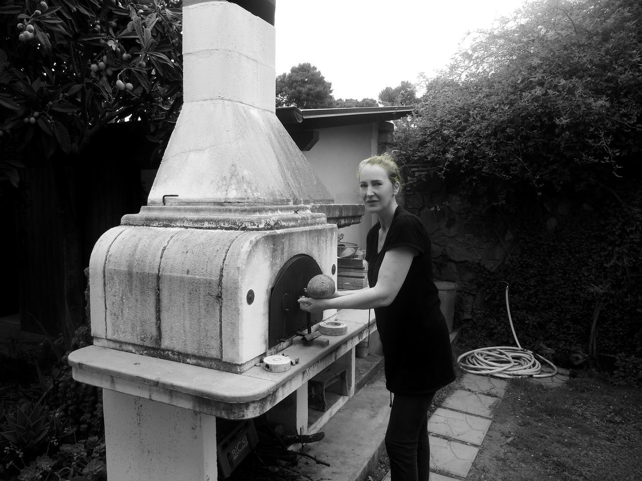 Home-Made Bread The Portraitist - 2017 EyeEm Awards Outdoors Young Women Real People People One Person Woman Portrait Smiling Portrait MUR B&W Looking At Camera Black And White Working Women Bread Making Oven Outdoors Photograpghy  Holisticlifestyle BYOPaper!