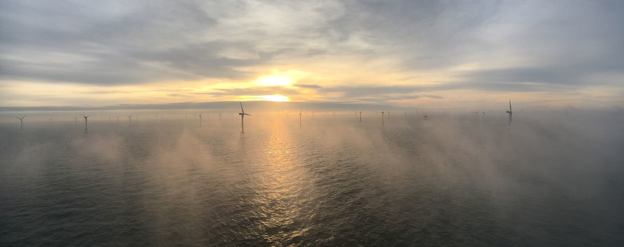 Water Sunset Sky Cloud - Sky Outdoors Day Work Construction Wind Renewable Energy Sea Windturbines No People Cloud Sailing Fly High Angle View Adventure Waterfront