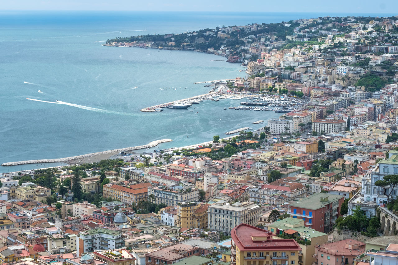 Aerial View Architecture Bay Beauty In Nature Blue Building Exterior Built Structure City Cityscape Copy Space Day Gulf Of Naples Harbor High Angle View Horizon Over Water Houses Mediterranean Sea Nature No People Outdoors Scenics Sea Sea And Sky Town Water