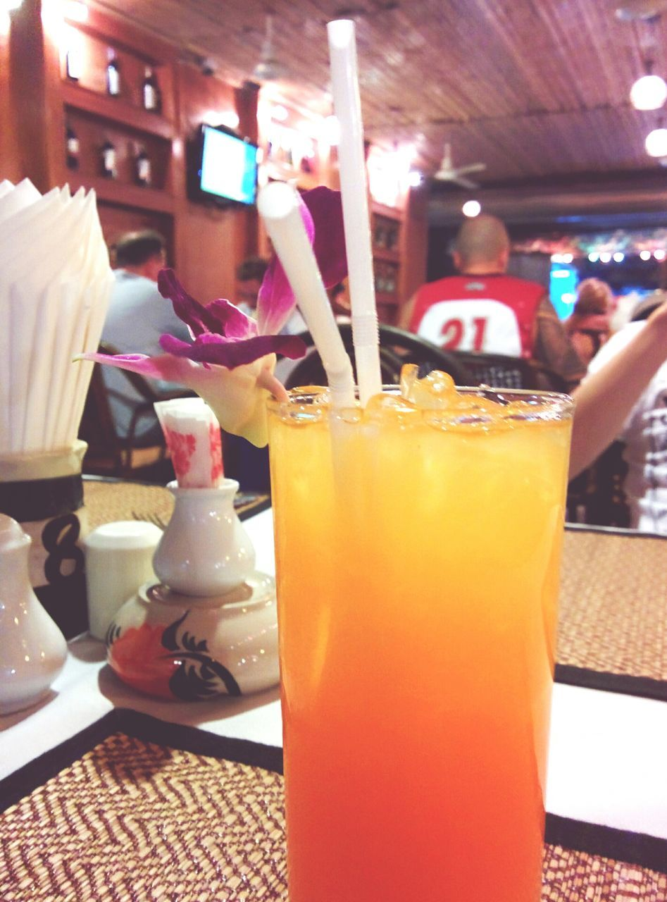 drink, drinking straw, refreshment, food and drink, drinking glass, freshness, indoors, table, close-up, focus on foreground, temptation, orange juice, healthy eating, smoothie, food, no people, cold temperature, multi colored, day, ready-to-eat