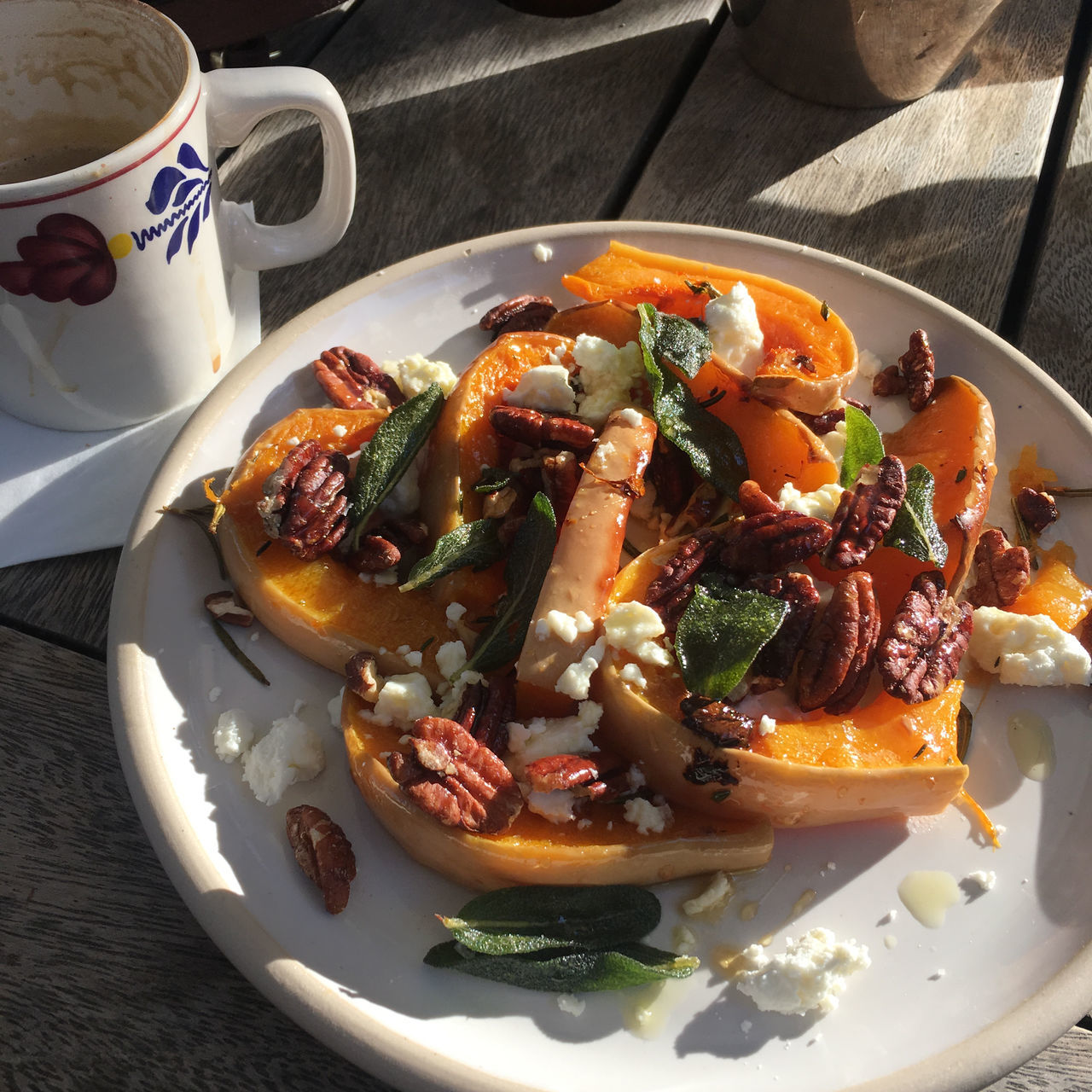 Roasted butternut squash with pecans and feta and a cappuccino Autumn Colours Autumn Sun Butternut Squash Cappuccino ♥ Cheese Close-up Comfort Food Day Feta Food Freshness Healthy Eating Lunch Maple No People Plate Ready-to-eat