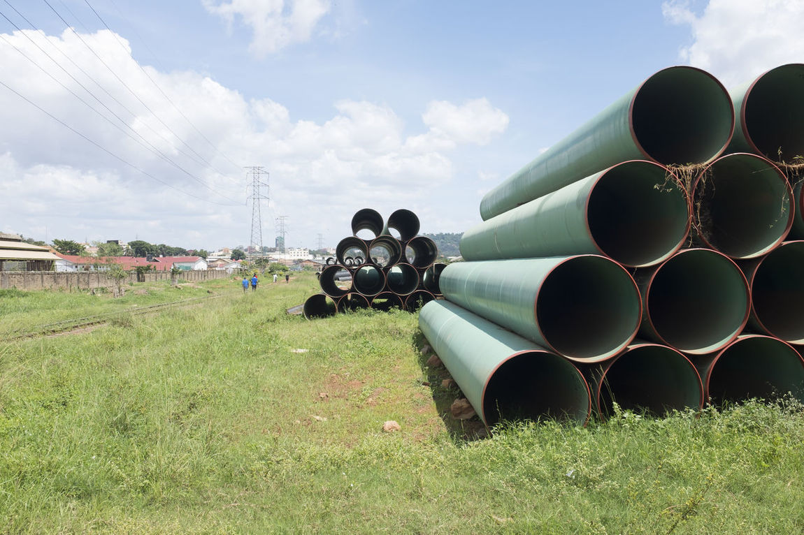 Africa African Building Materials Circles Construction Construction Materials Construction Site Metal Metal Pipe Outdoors Pipes Piping Stack Stacked Train Tracks