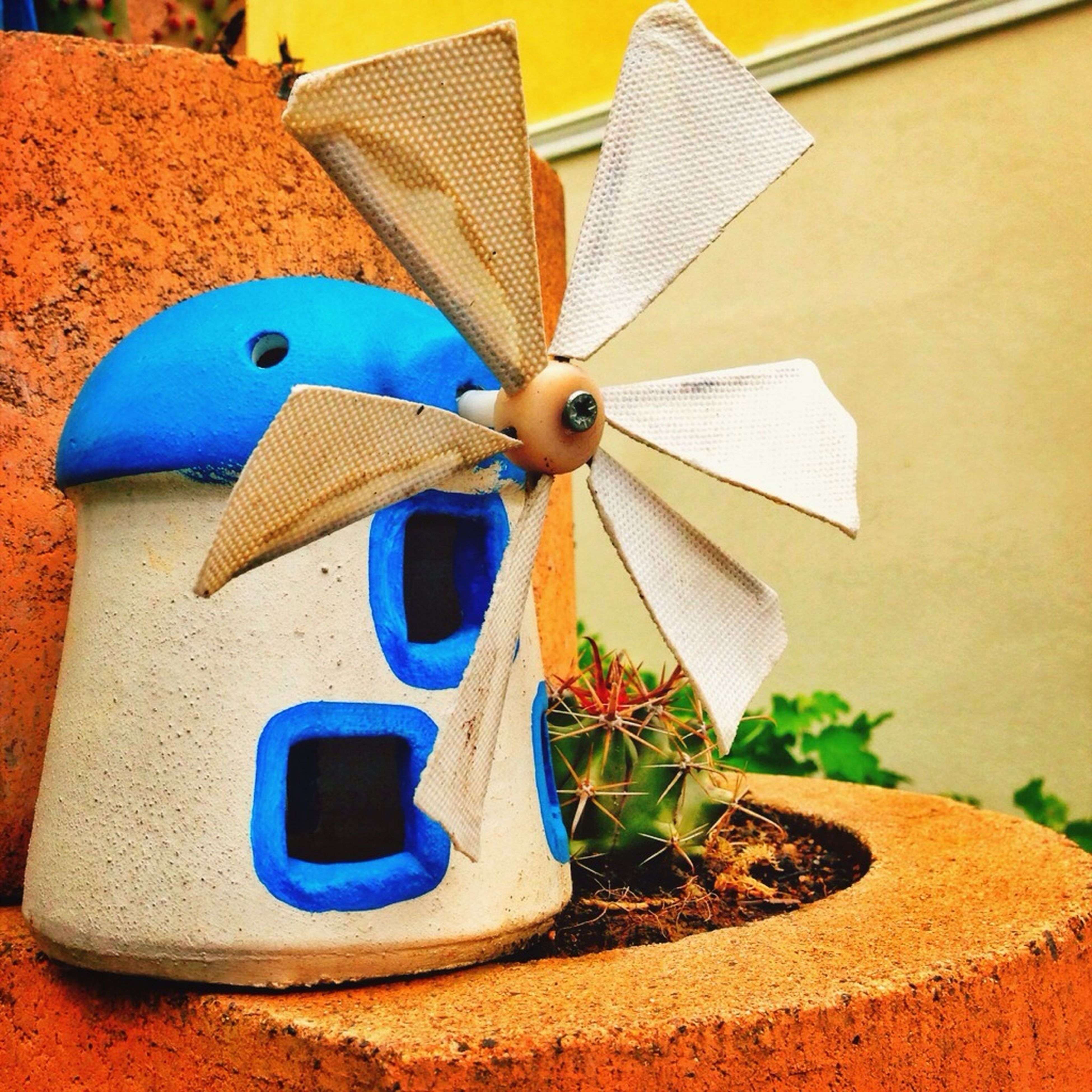art and craft, art, animal representation, blue, creativity, multi colored, toy, close-up, outdoors, wall - building feature, no people, butterfly - insect, day, one animal, craft, built structure, animal wing, decoration, insect, architecture