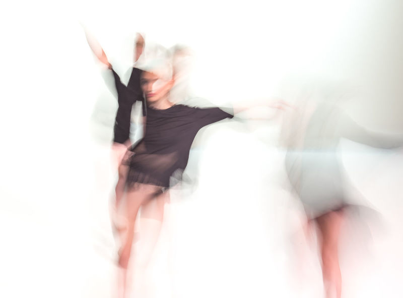 Abstract Photography Blurred Dance Performance Dancing Experimental Folkwang University Abstract Beautiful Woman Blurred Motion Blurred Movement Dancing Day Defocused Energetic Experimental Photography Front View Full Length Indoors  Long Exposure Motion One Person People Real People White Background Young Women The Week On EyeEm AI Now